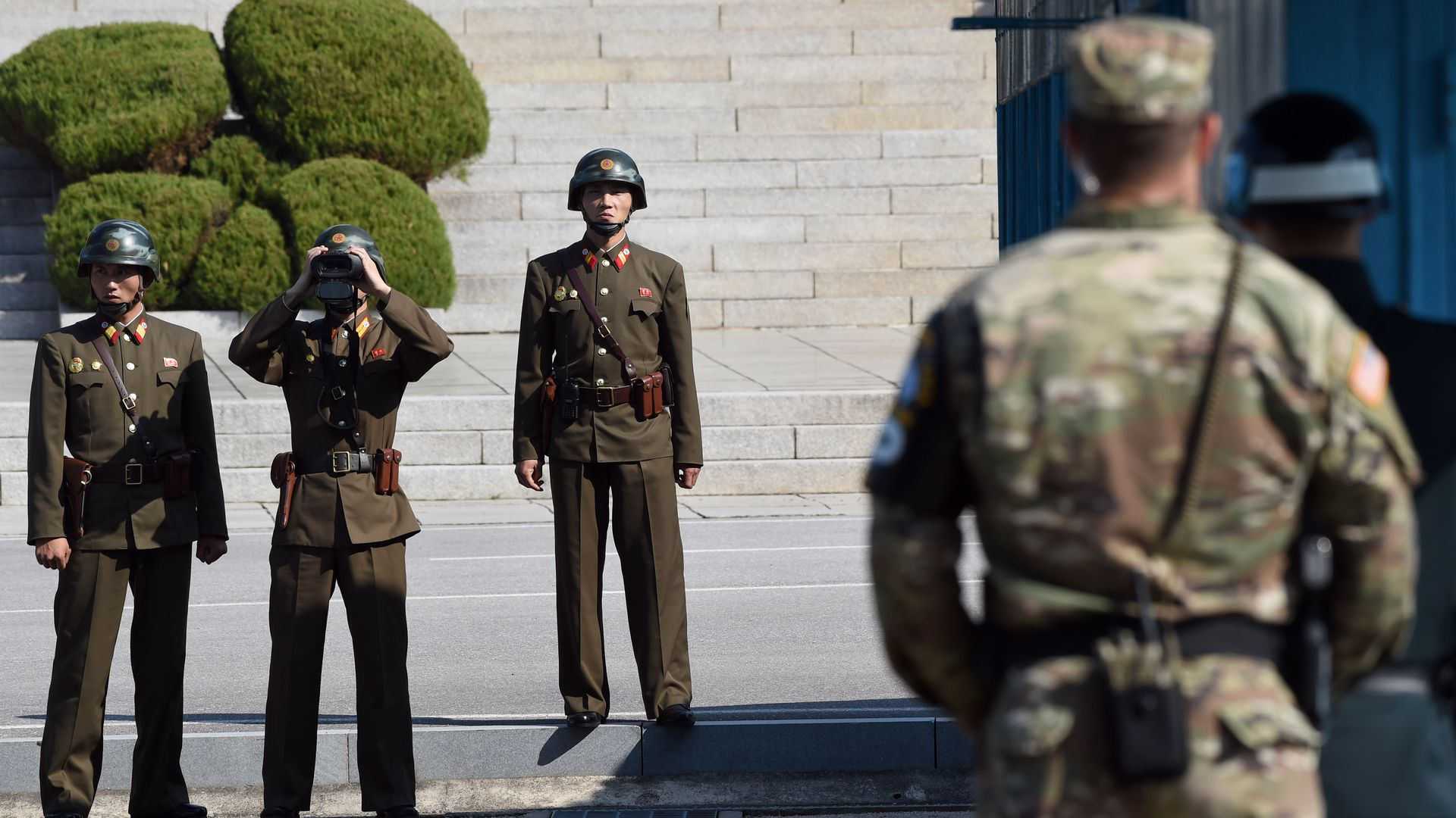 North Korean soldiers look at the South Korean side on the border between North and South Korea on October 27, 2017.