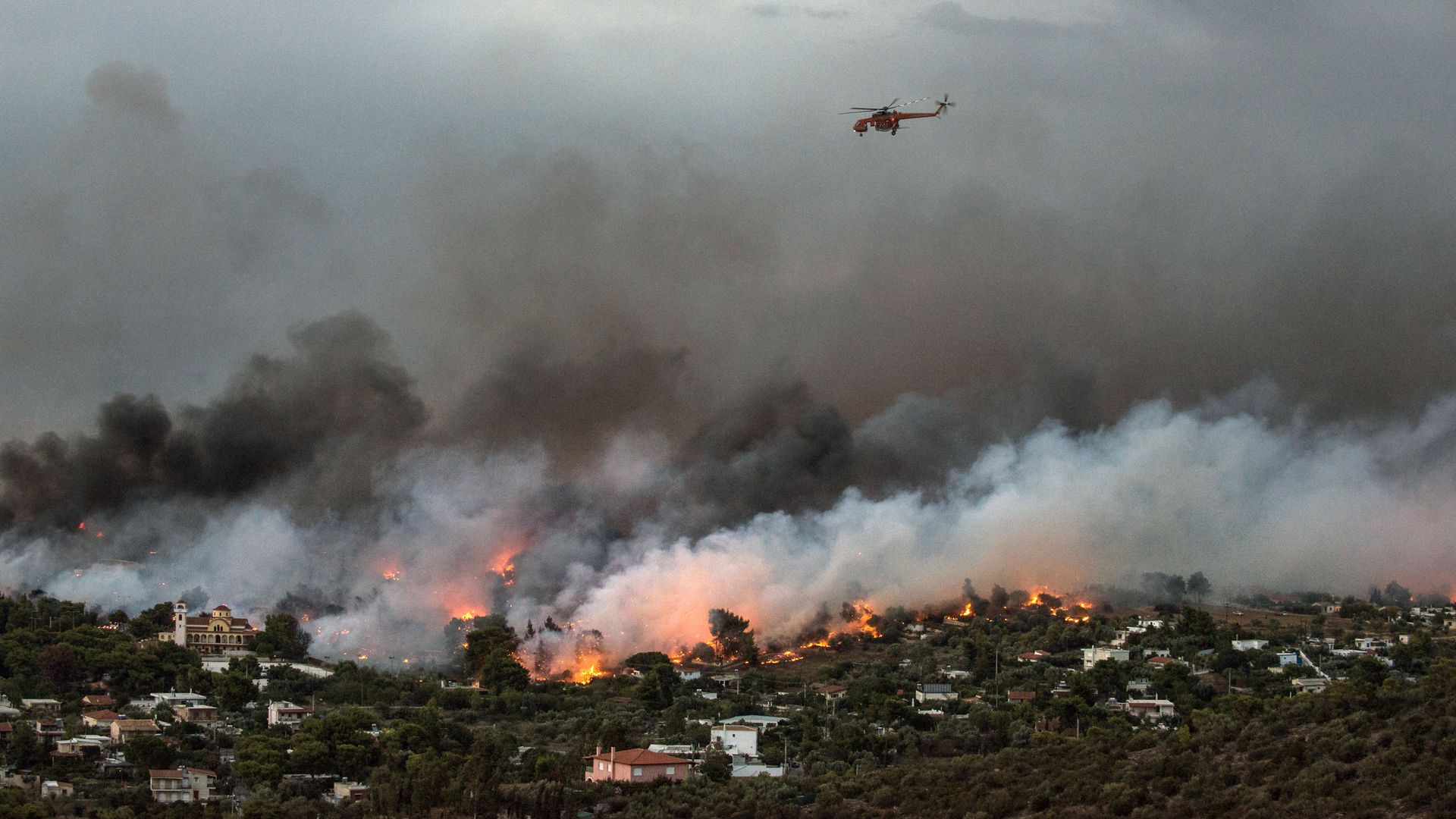 Helicopter flying over wildfires in Greece
