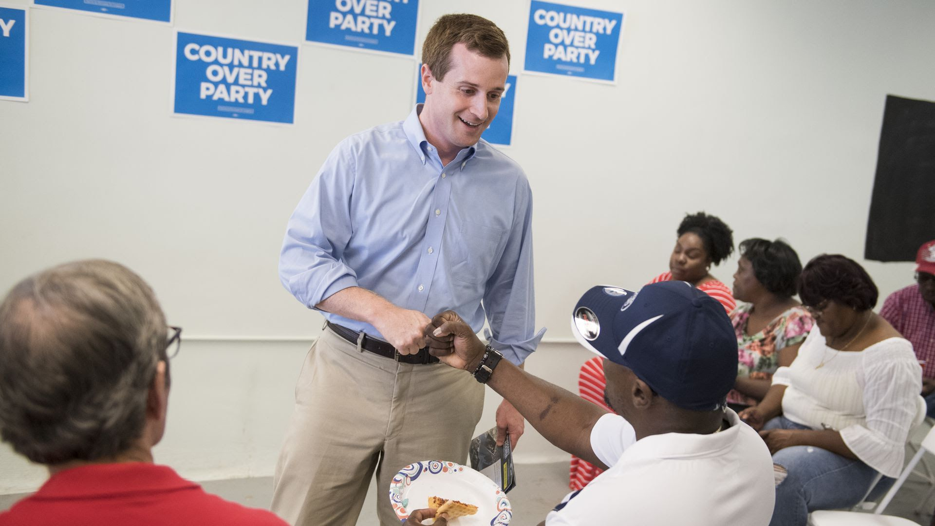 Congressional candidate Dan McCready shakes a voter's hand last month