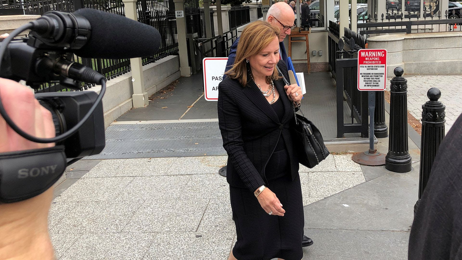 GM CEO Mary Barra departs the White House on Sept. 5