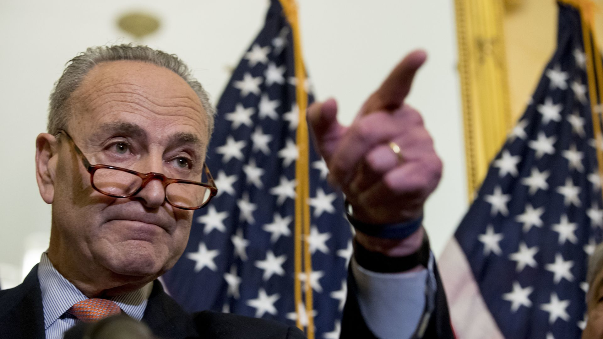 Chuck Schumer calling on a reporter during a press conference on Capitol Hill.