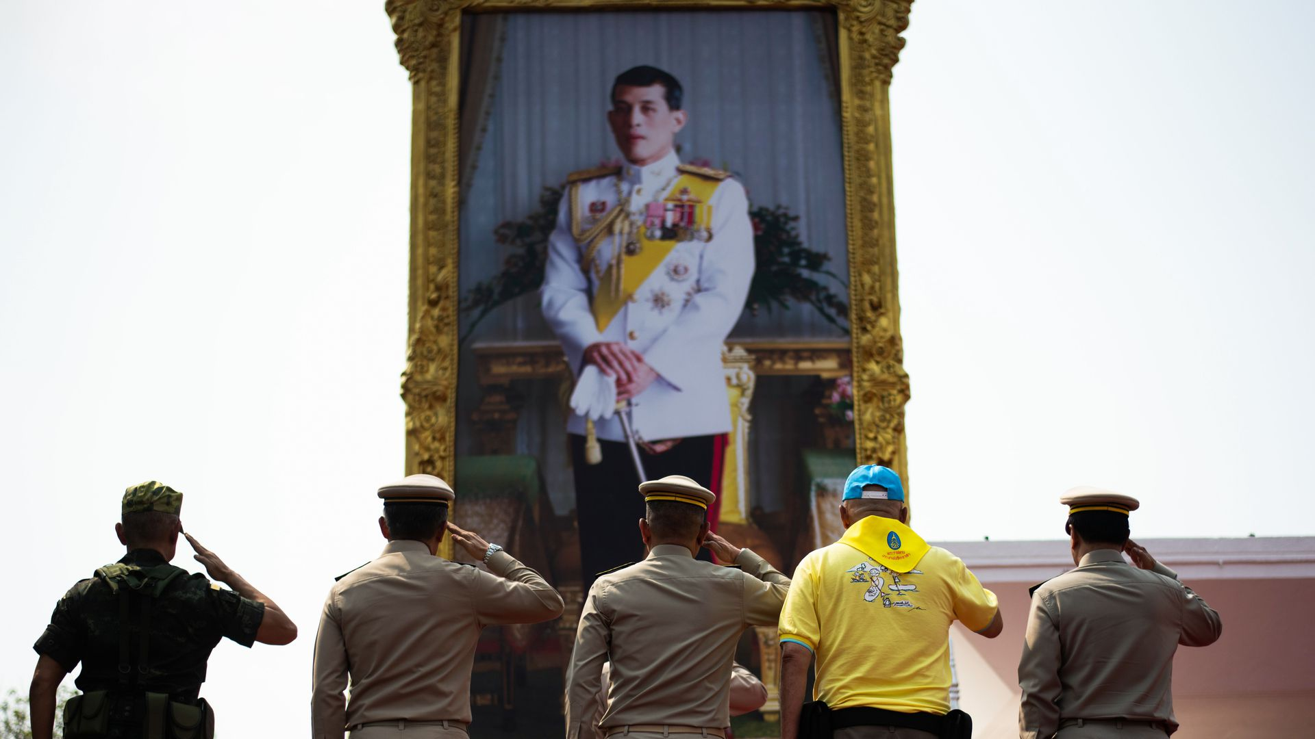 Thai Prime Minister, Royal Thai Army Commander in Chief and others salute a portrait of King Maha Vajiralongkorn