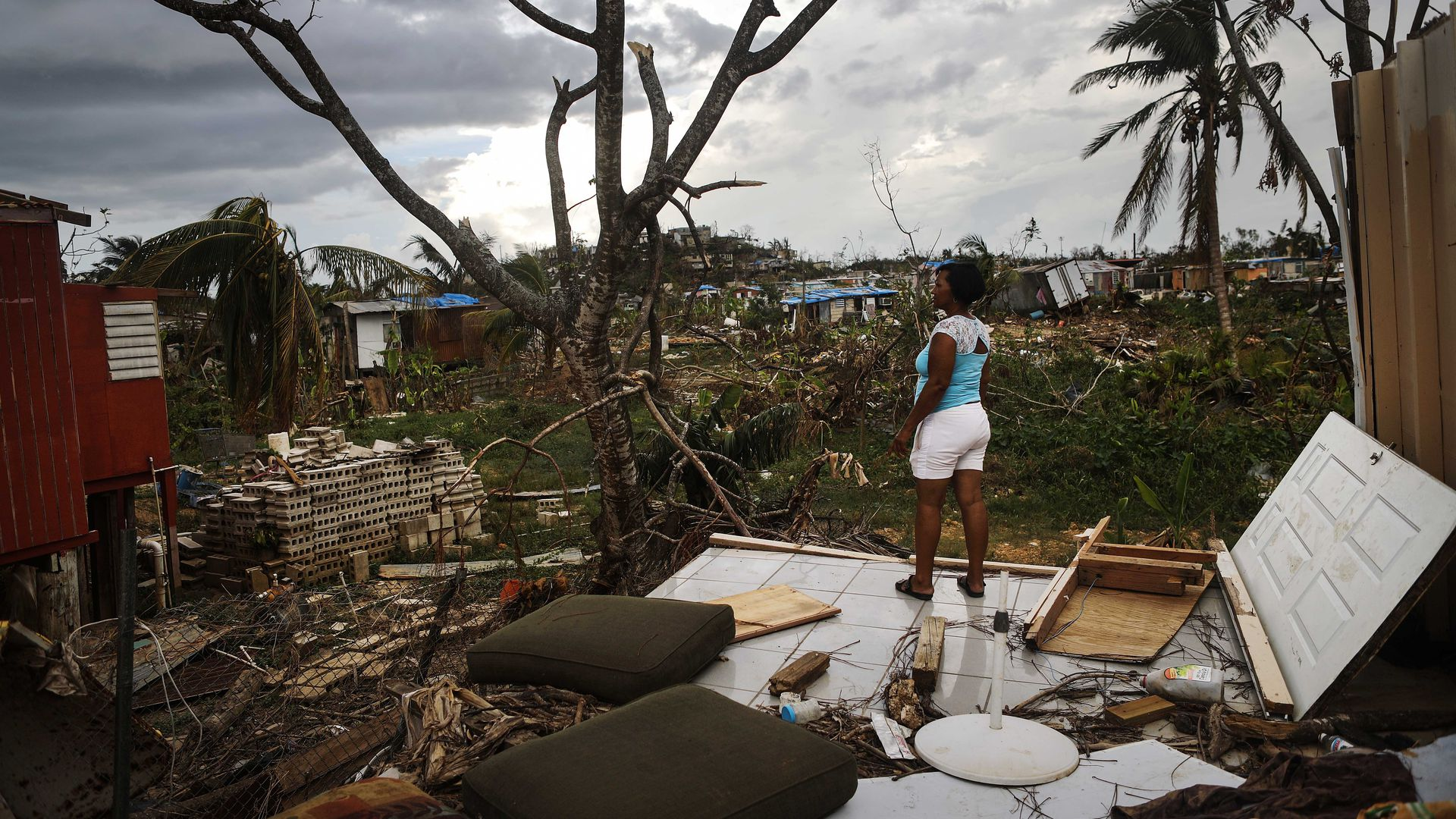 A resident stands on her property after Hurricane Maria swept through Puerto Rico.