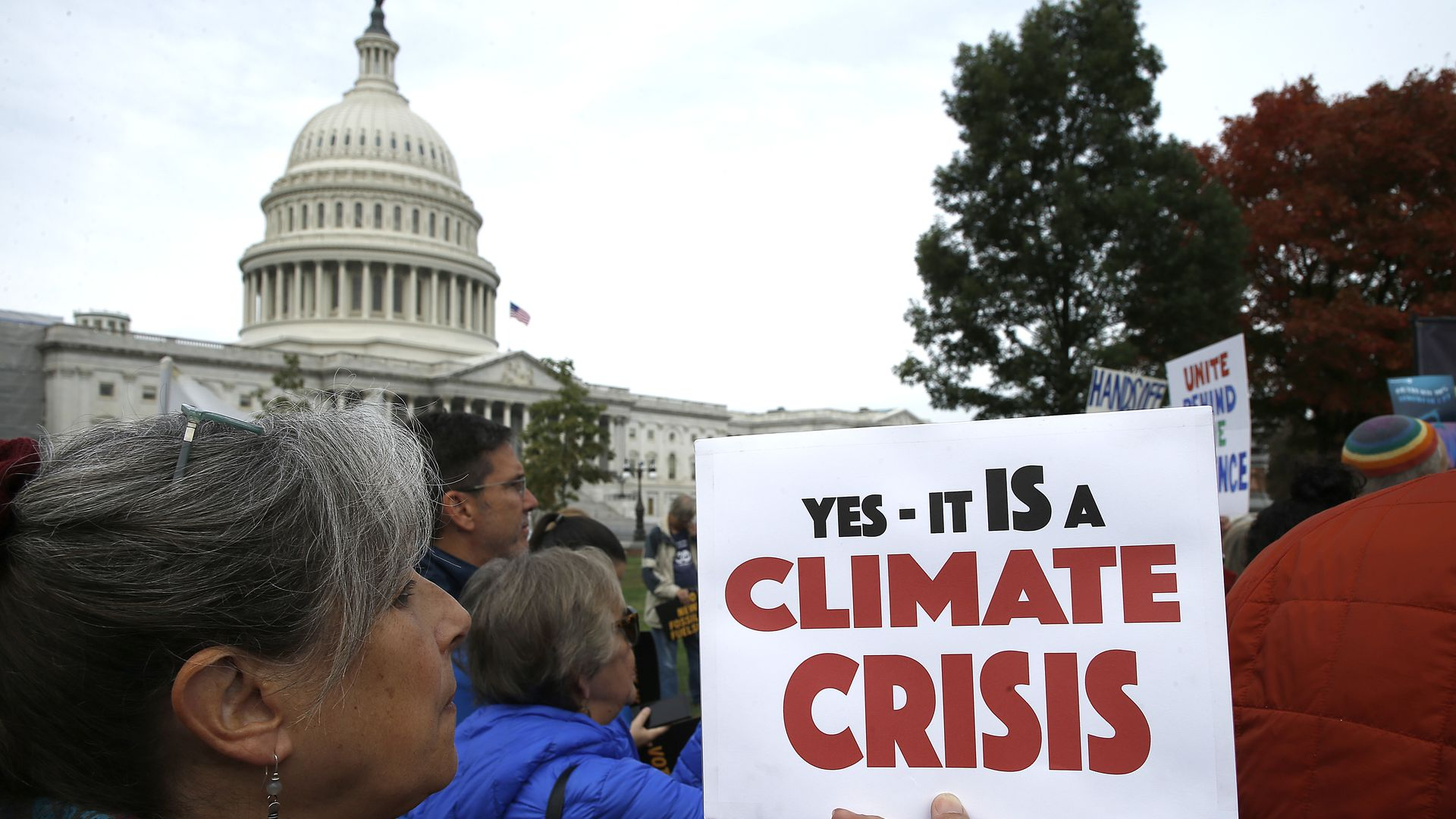 Climate protestors outside Congress