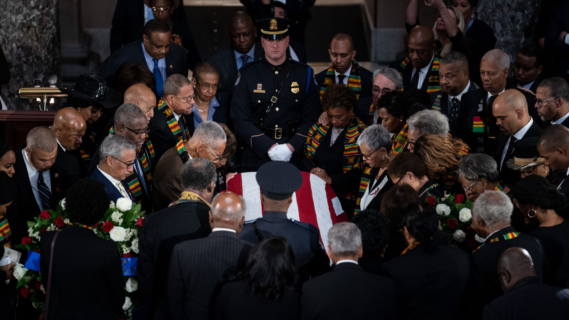 Members of the Congressional Black Caucus pray over the casket of Rep. Elijah Cummings (D-Md.)