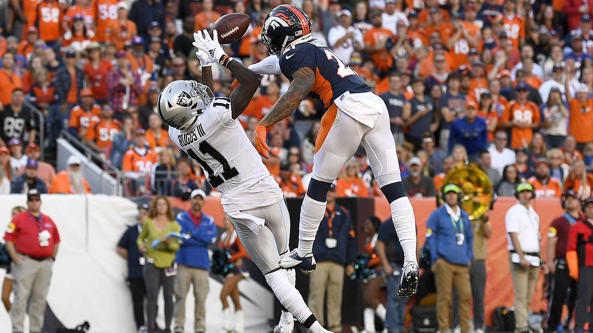 Henry Ruggs III #11 of the Las Vegas Raiders completes a catch against Ronald Darby #21 of the Denver Broncos during the third quarter at Empower Field At Mile High on Oct. 17.