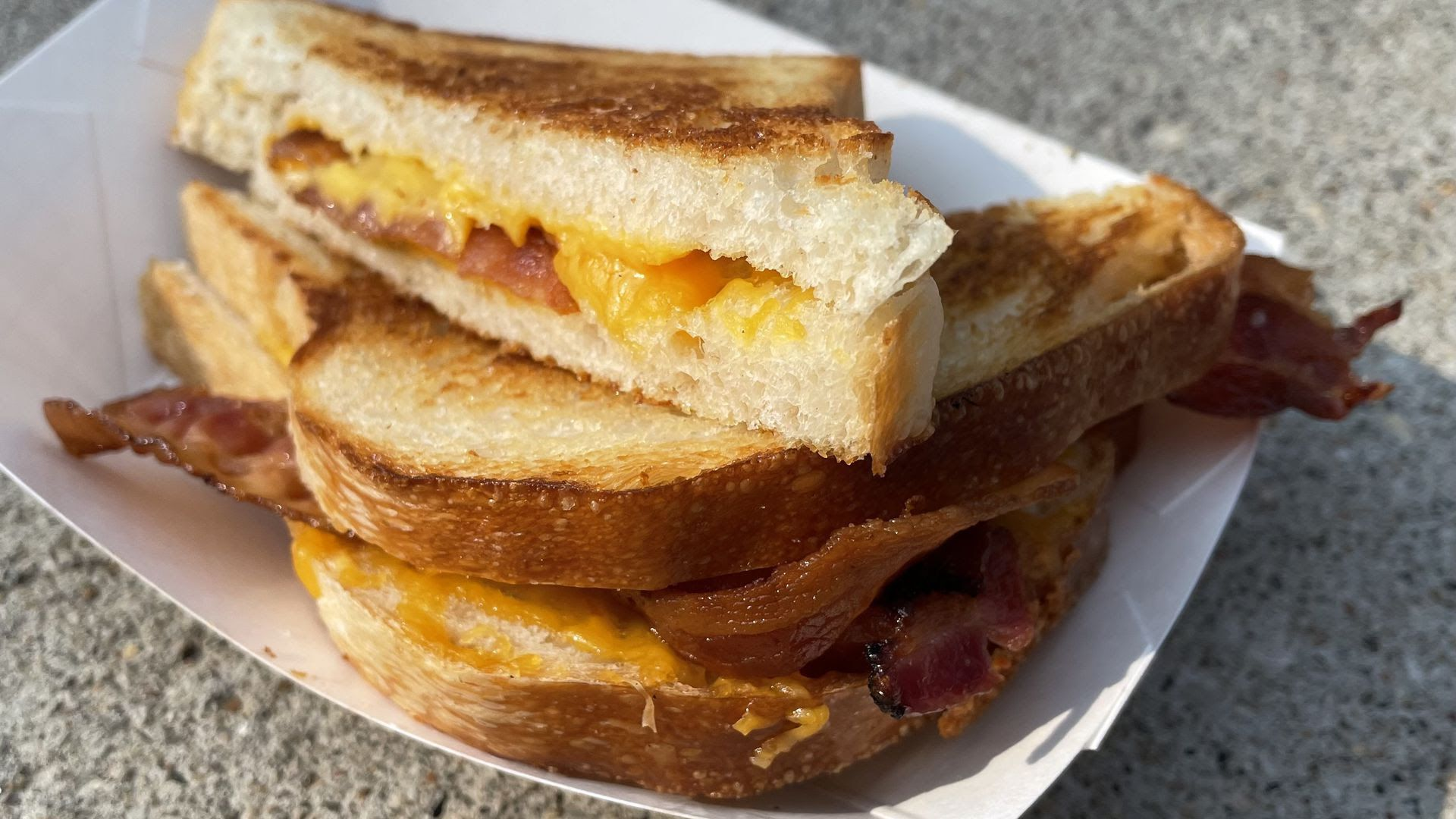 A grilled cheese with bacon.