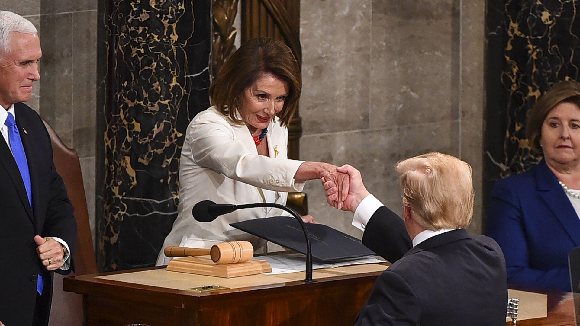 House Speaker Nancy Pelosi and President Trump shake hands.