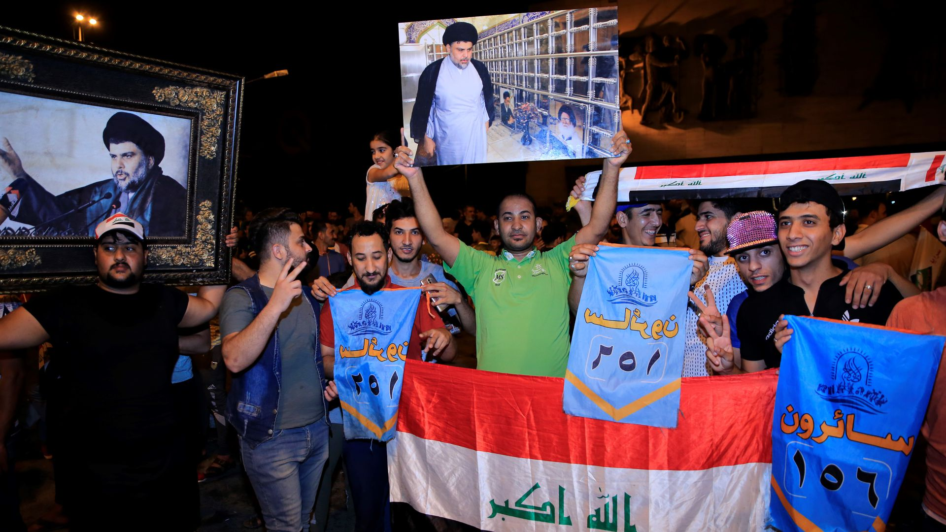 Supporters of Iraqi Shiite cleric Moqtada al-Sadr celebrate the results of the parliamentary election at the Tahrir Square, Baghdad, Iraq, on May 13, 2018.