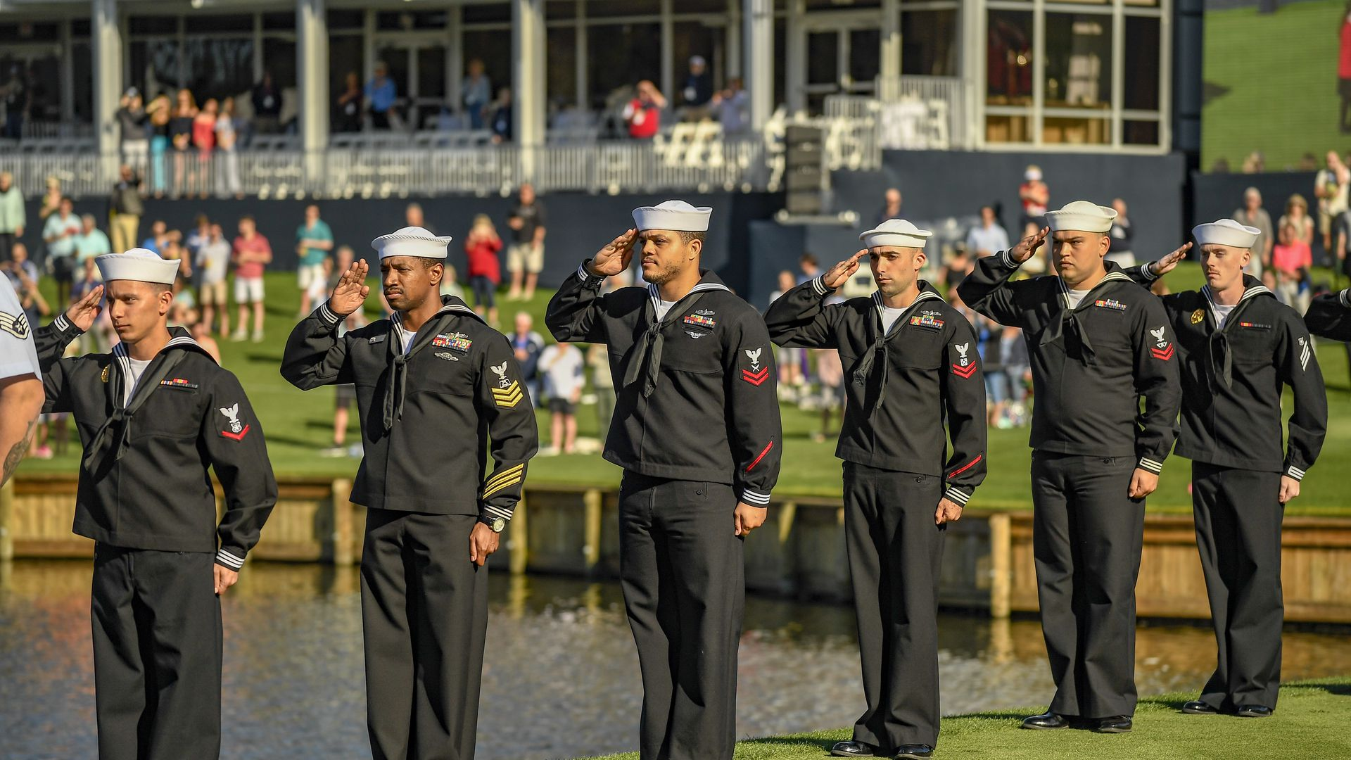 U.S. sailors saluting the flag