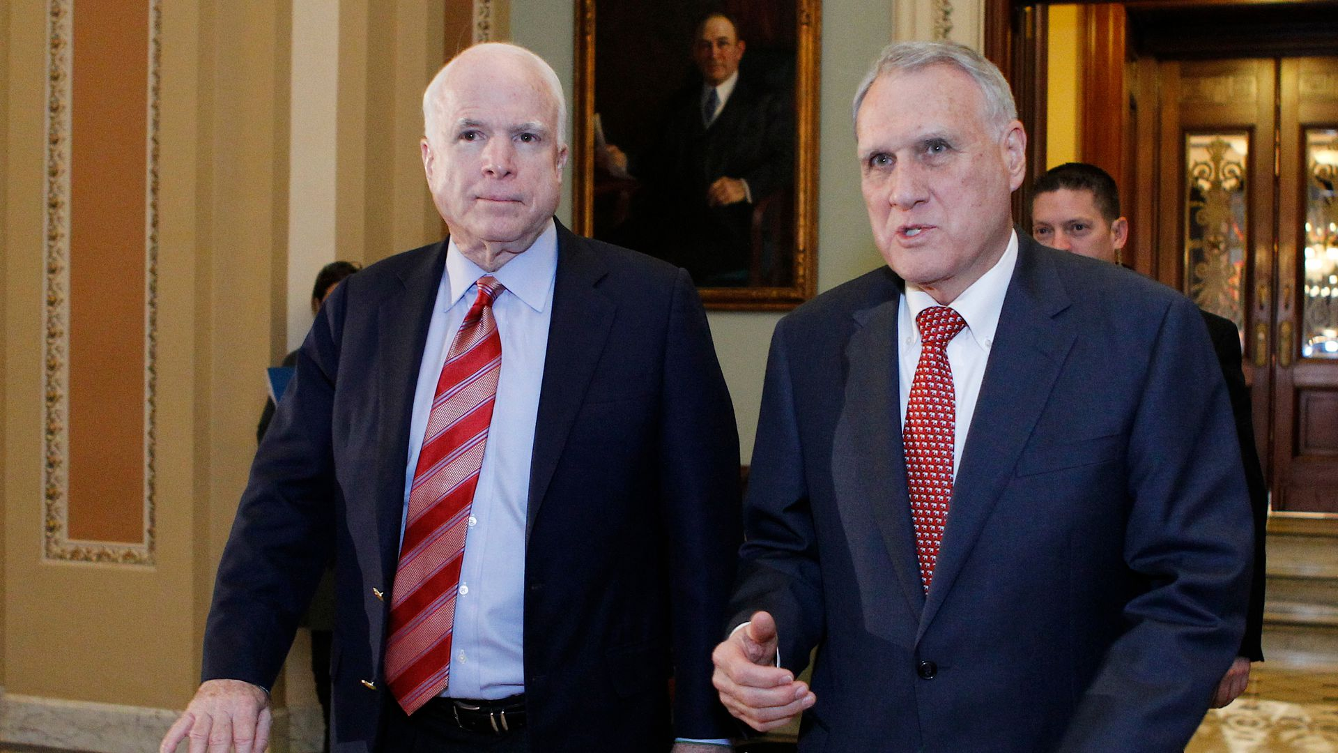 John McCain and Jon Kyl walking in Senate.