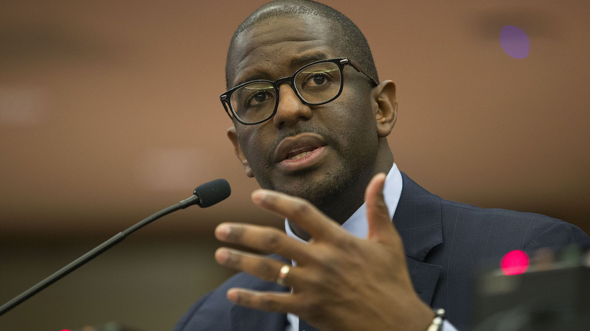 Gillum speaking into a microphone