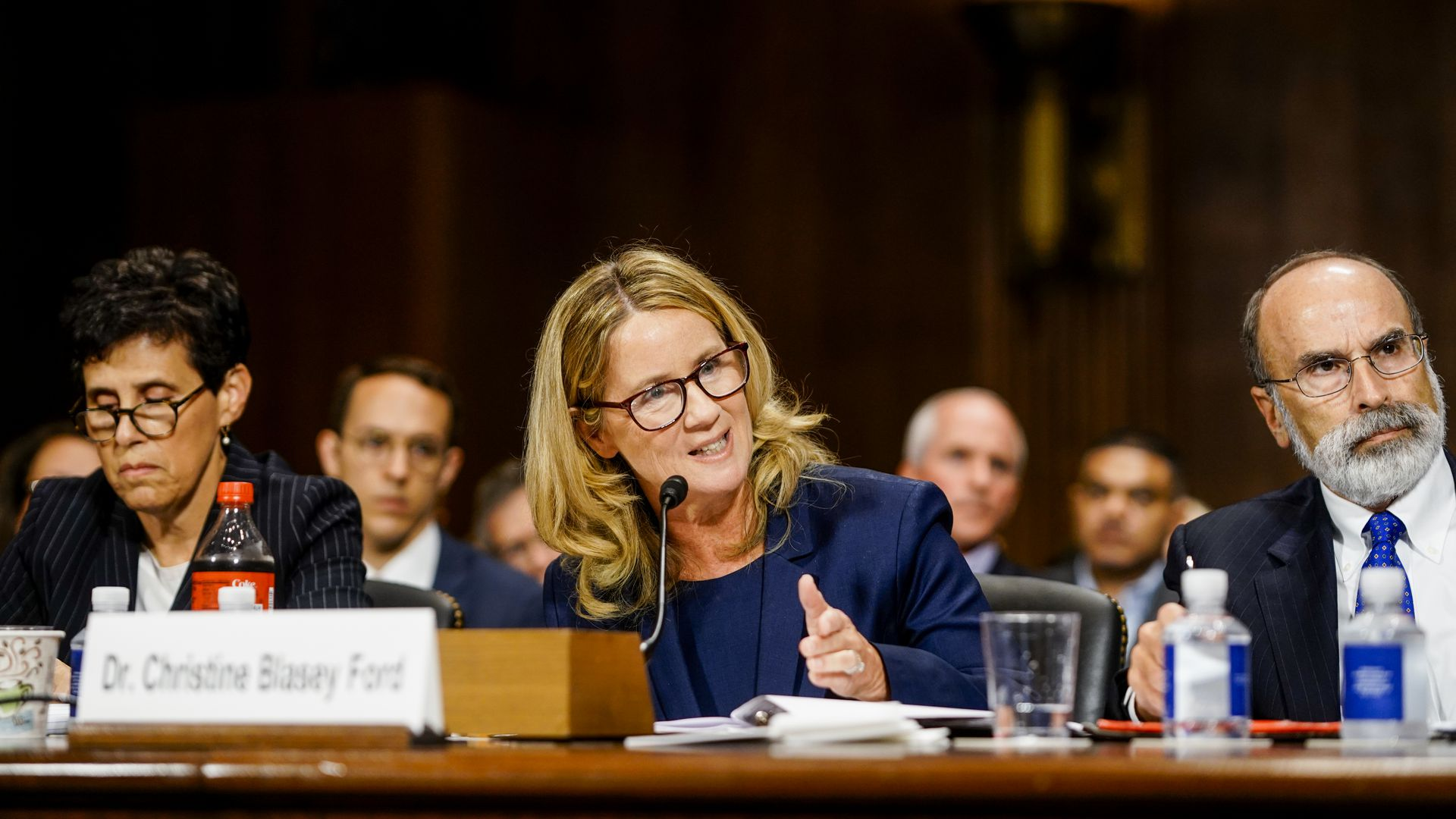 Christine Blasey Ford sitting at a table during the senate hearing.