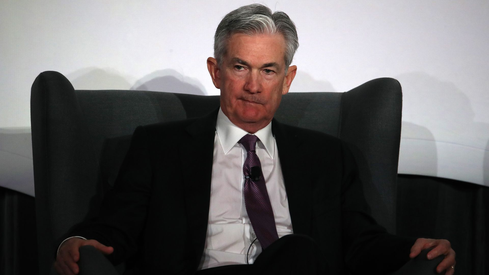 Chairman of the Federal Reserve Jerome Powell sitting in a chair