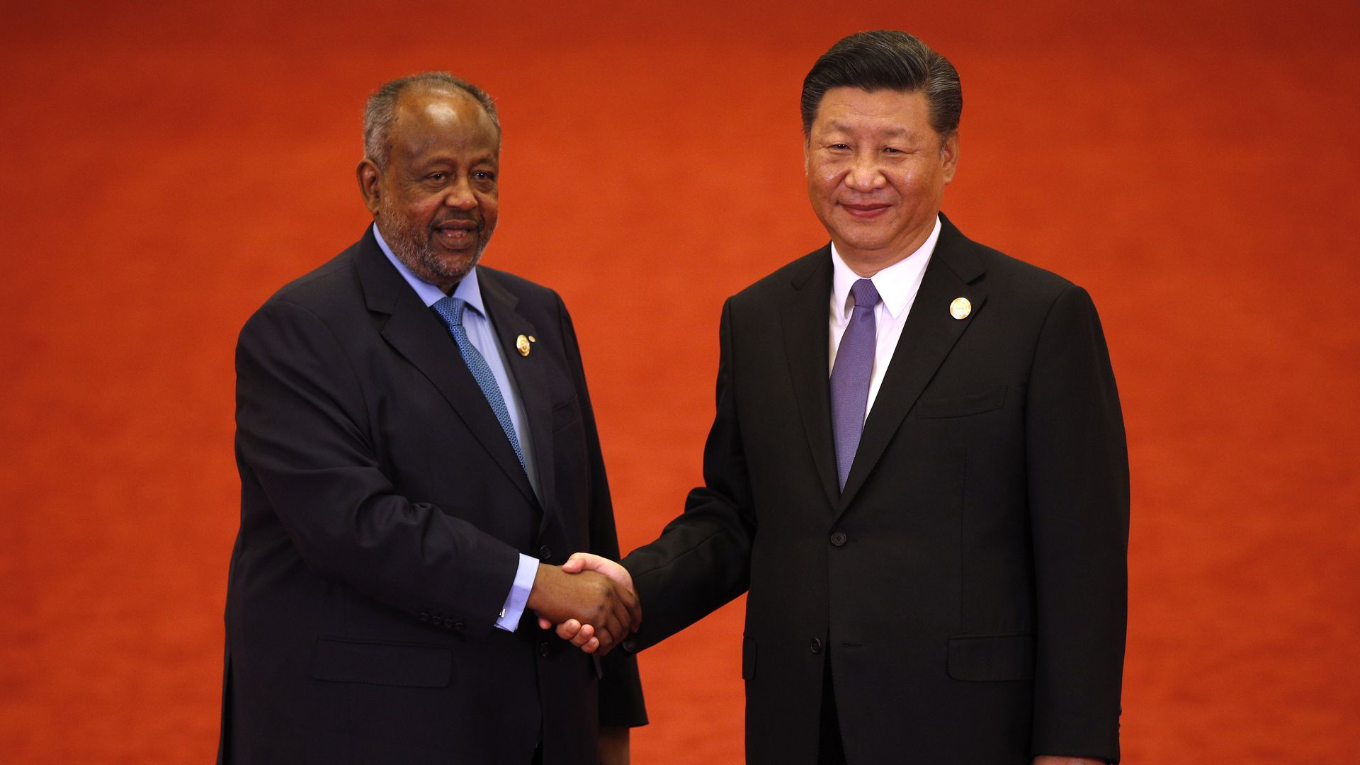 Djibouti's President Ismail Omar Guelleh shakes hands with Chinese President Xi Jinping during the Forum on China-Africa Cooperation on September 3, 2018 in Beijing, China.