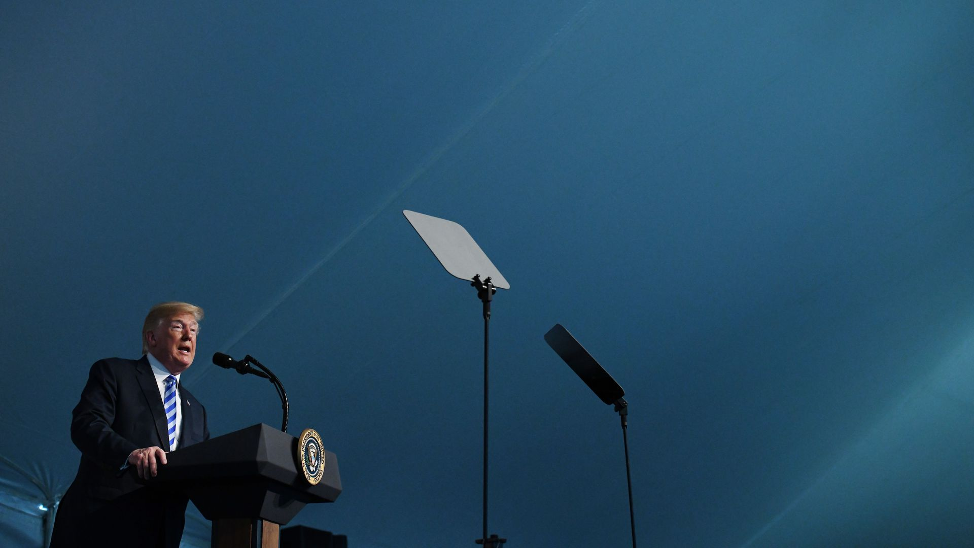 President Trump speaking at a podium.