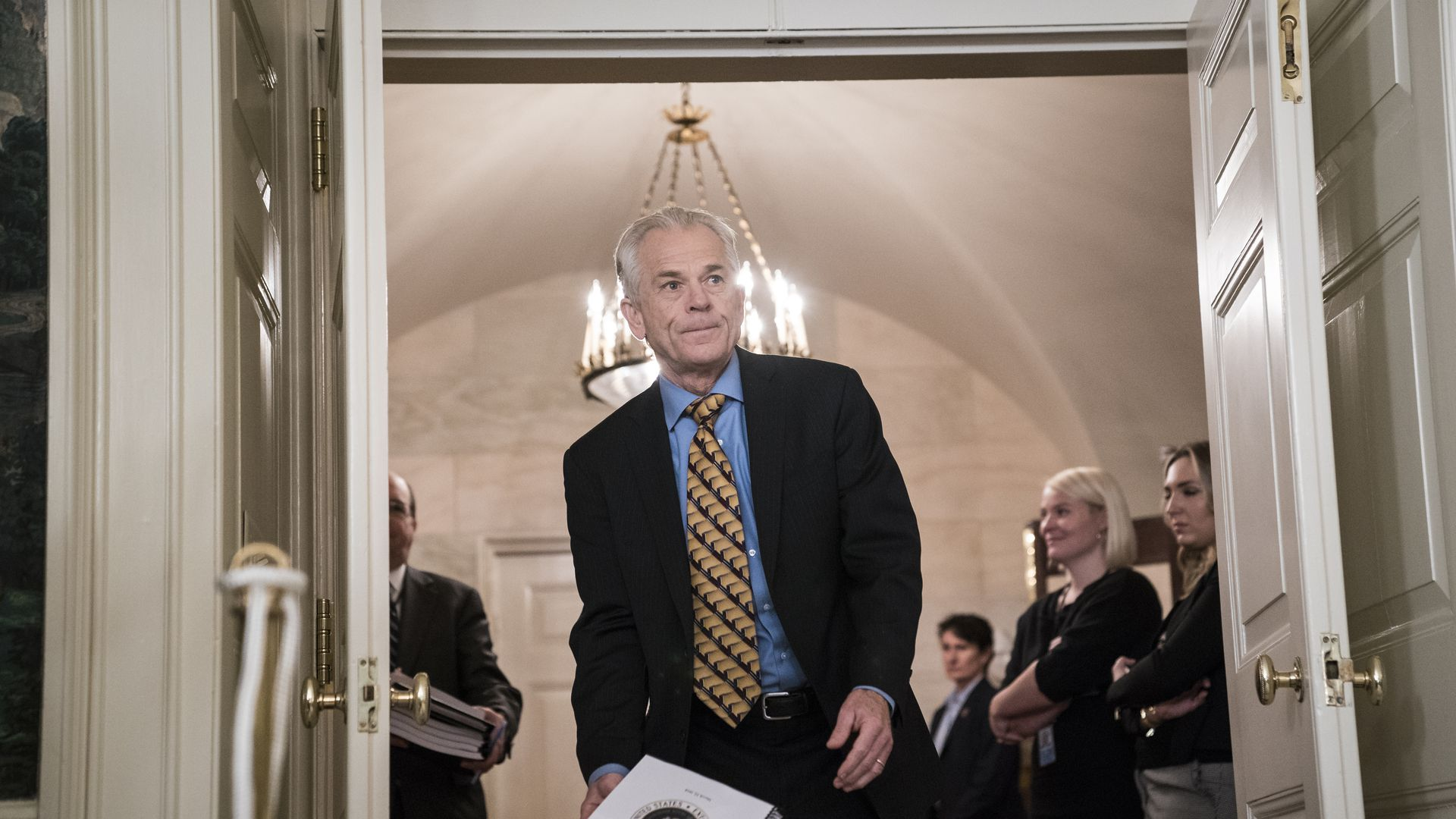 Peter Navarro, Assistant to the President, walks through a door in the White House