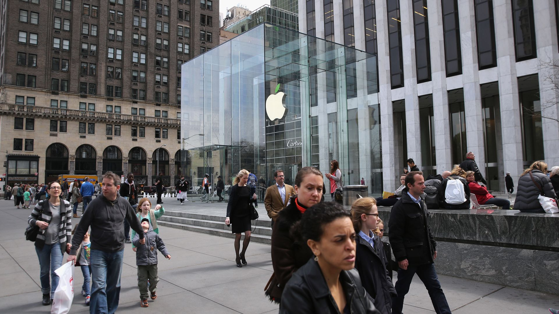 People walk past the Apple store in Manhattan