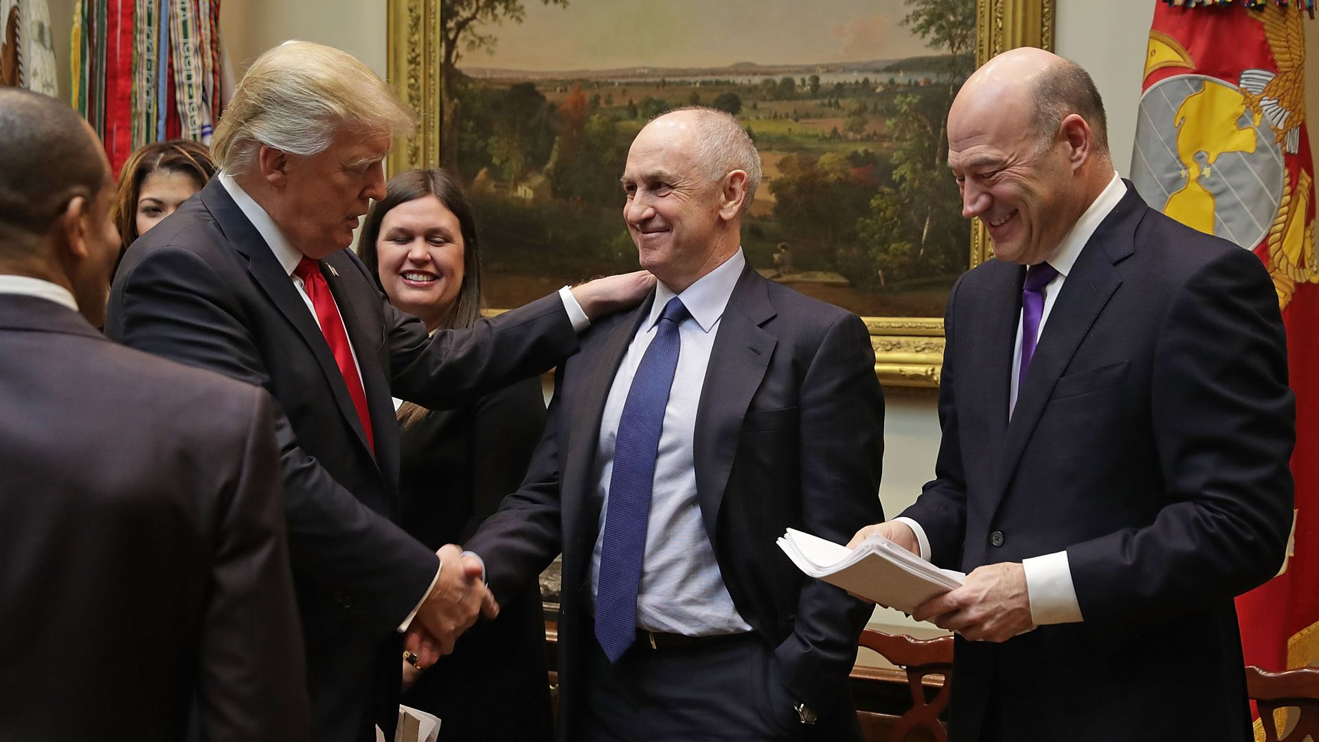 Donald Trump with Chris Liddell and Gary Cohn.