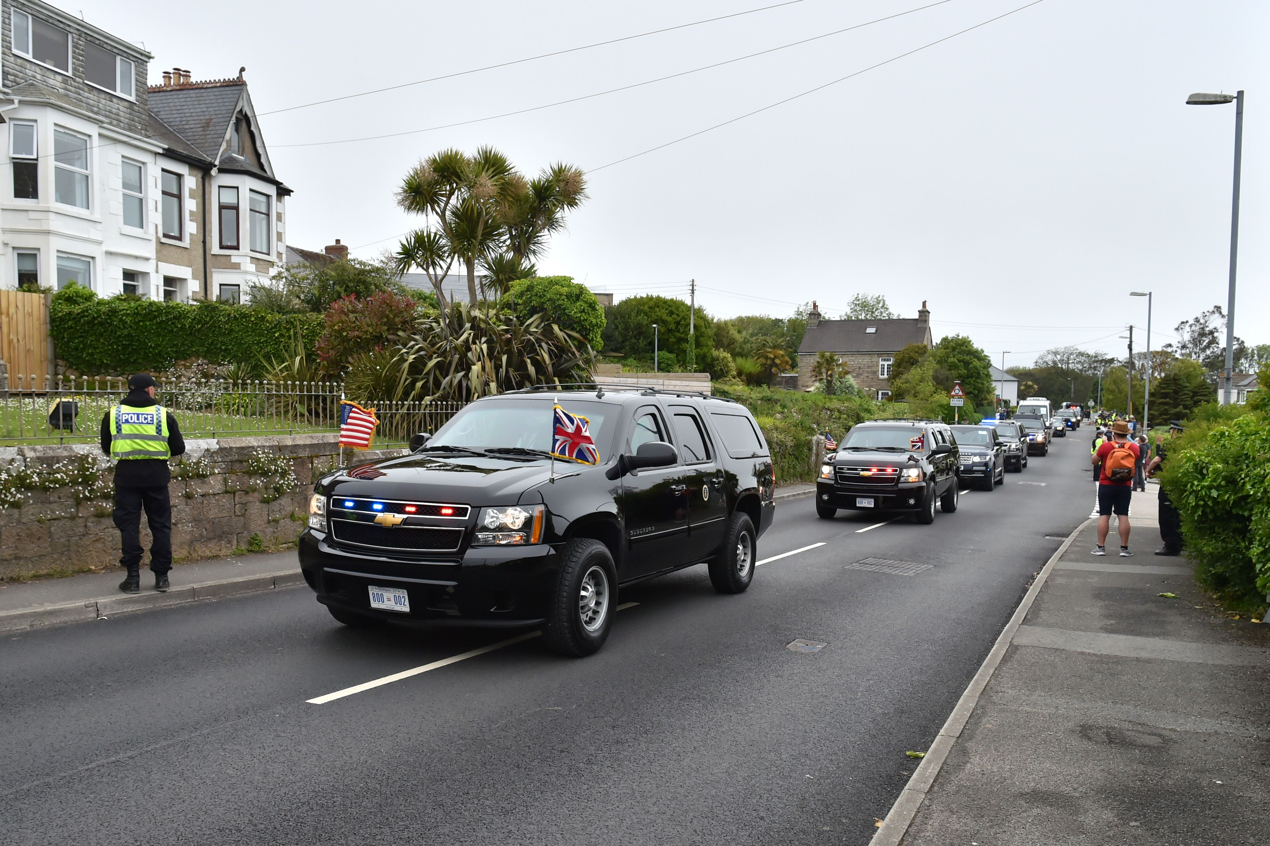 An SUV vehicle displaying both the UK and USA flags, forming part of the US motorcade carrying US President Joe Biden.