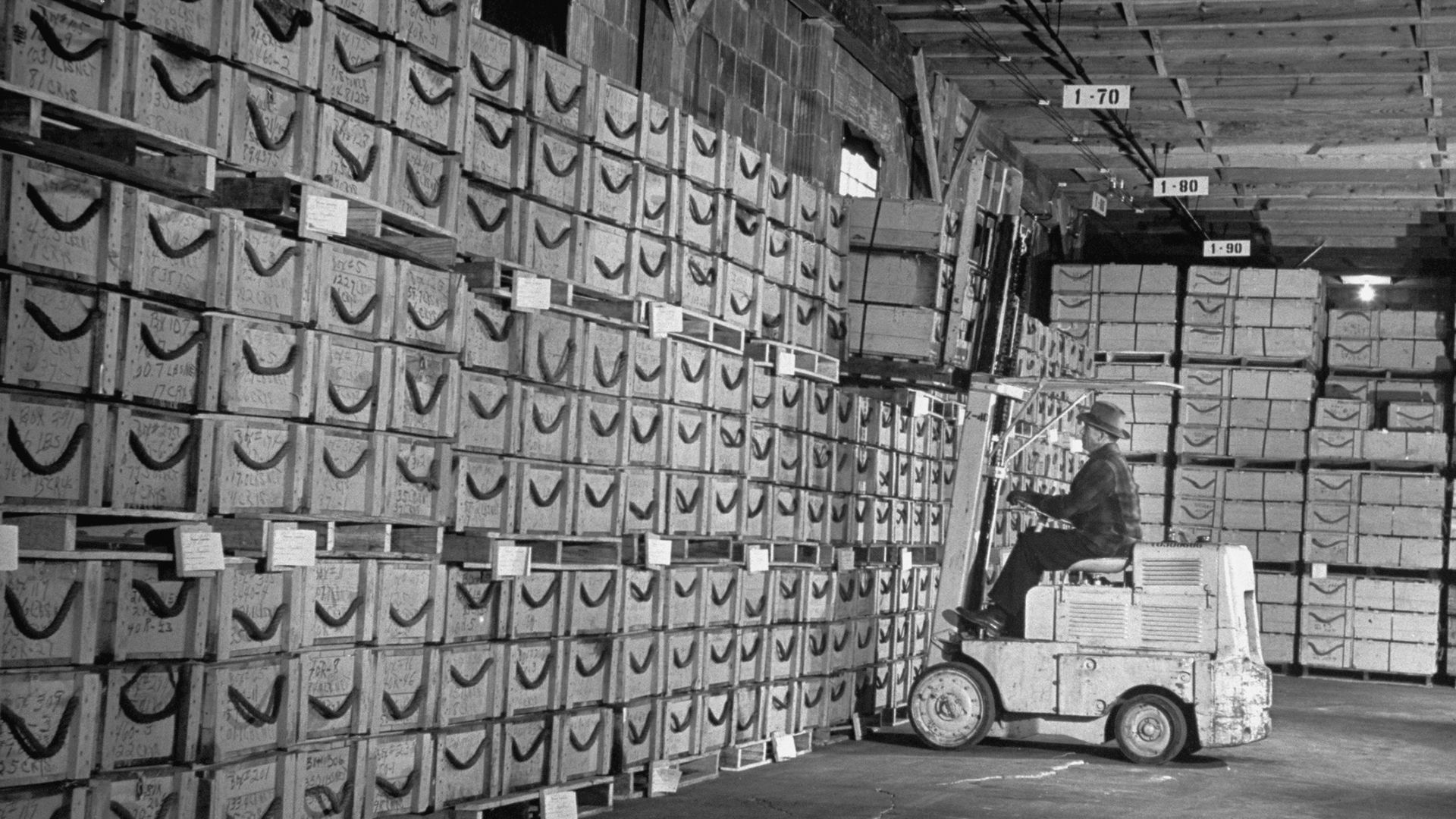 A forklift operator lifts crates full of quartz crystals in this photo from 1948.