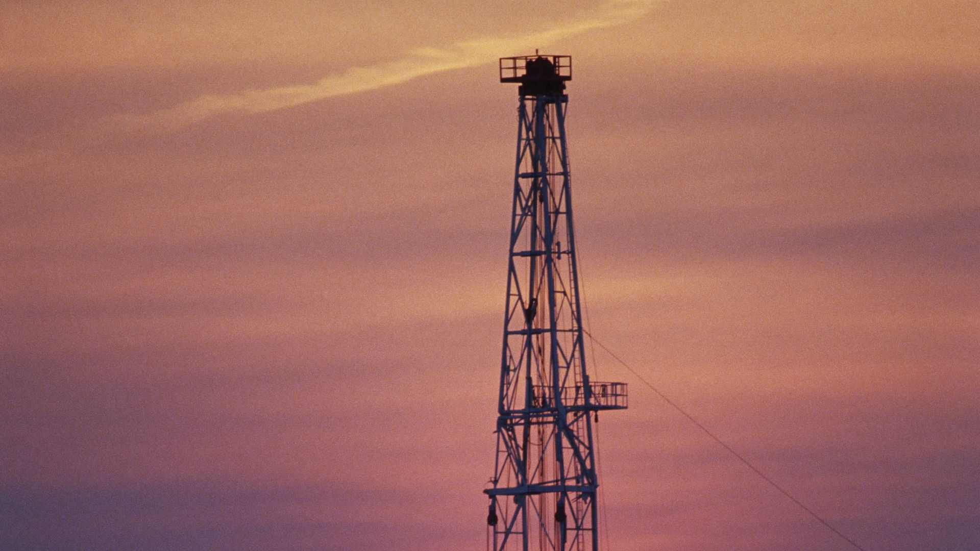 An oil well at sunset is silhouetted at sunset outside Jeddah, Saudi Arabia.