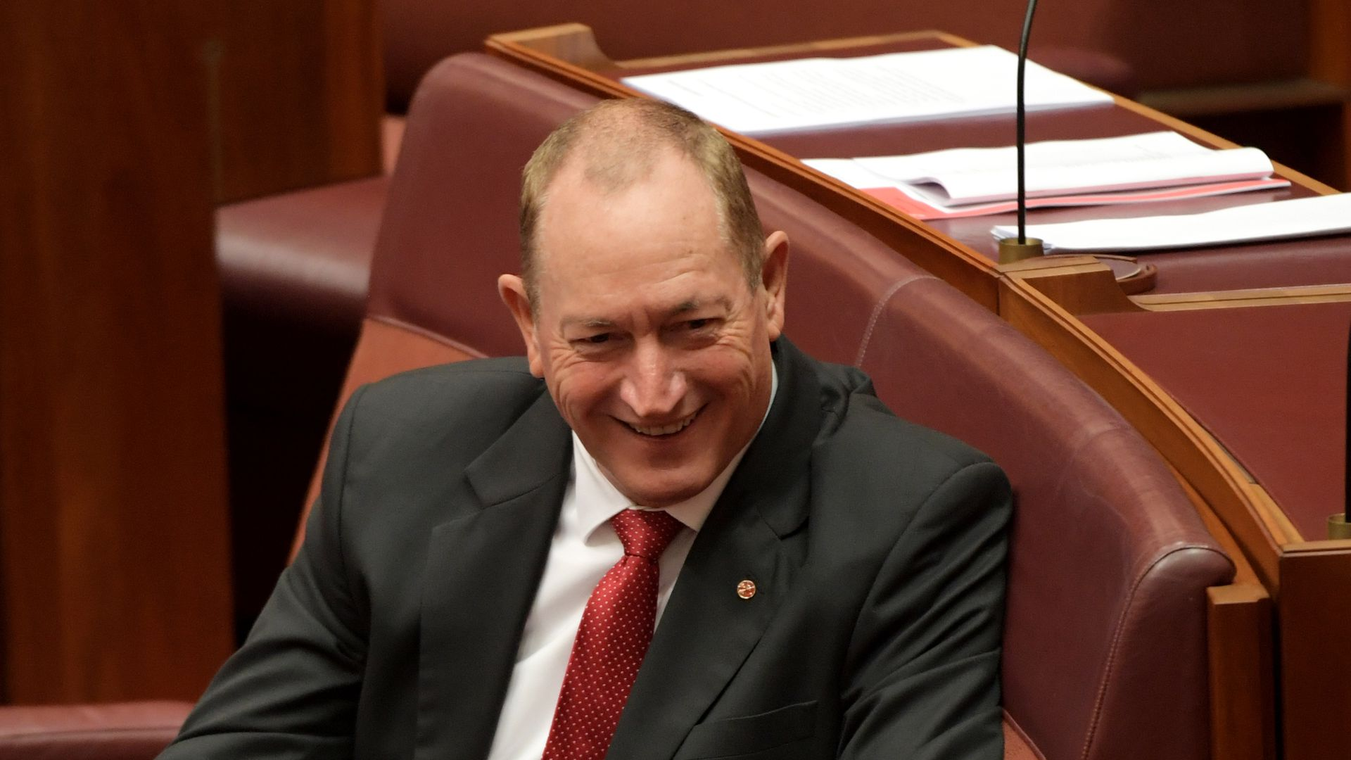 Sen. Fraser Anning smirks as he's censured in the Australian Senate.