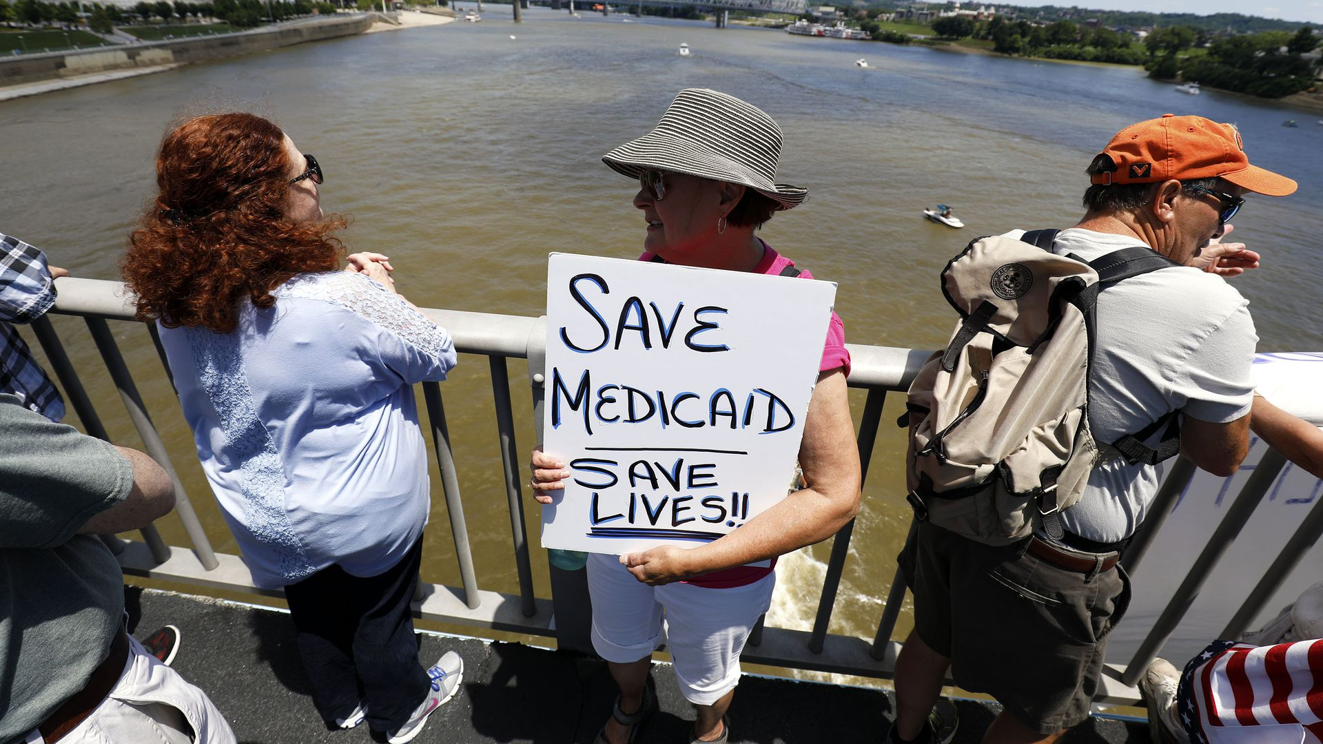Kentucky woman with sign that says save medicare saves lives