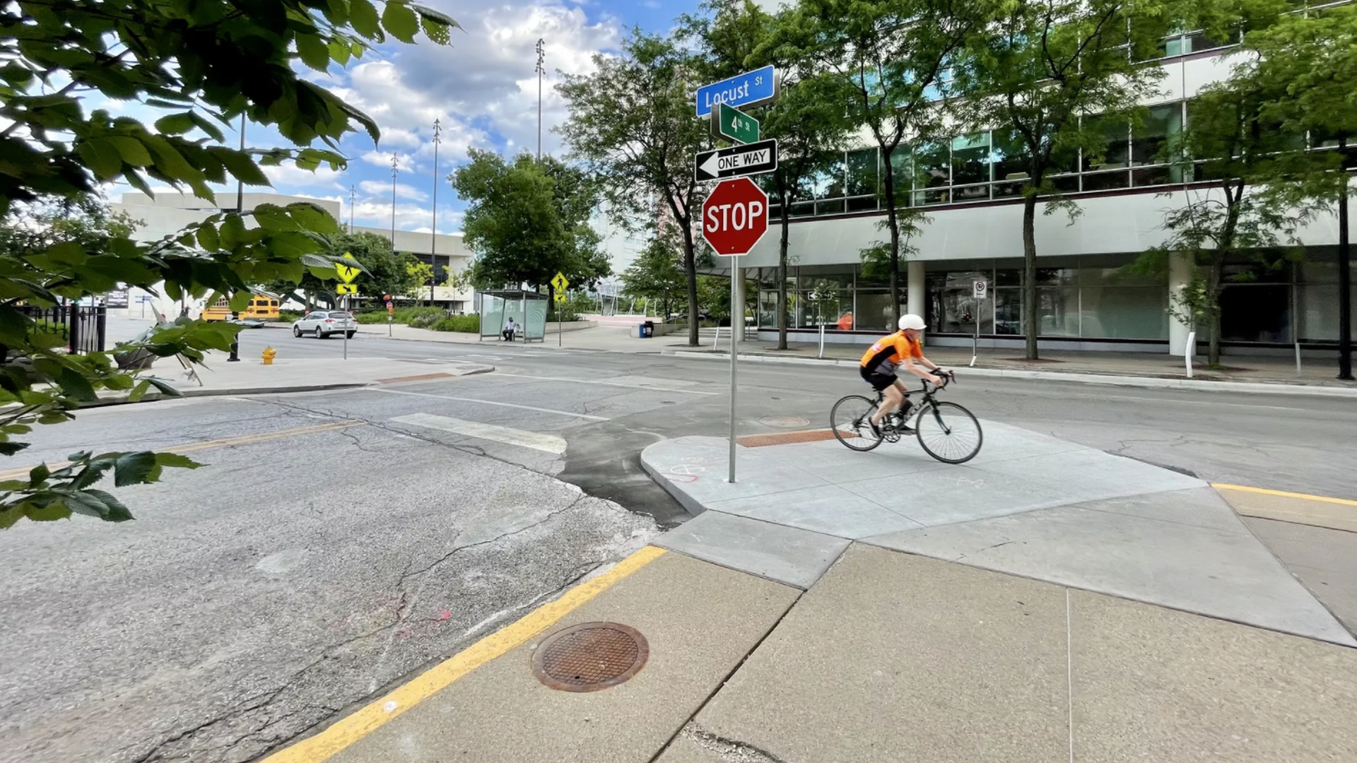 A bicyclist riding by a bumpout near the corner of 4th and Locust streets in Des Moines.