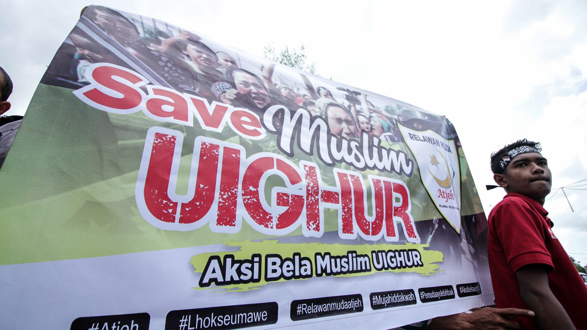 Save Muslim Uighur sign