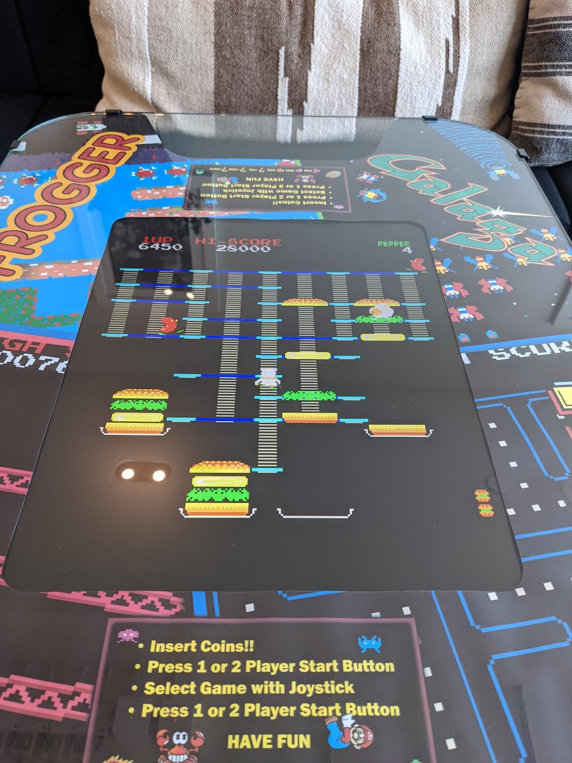 A picture of the BurgerTime arcade game.