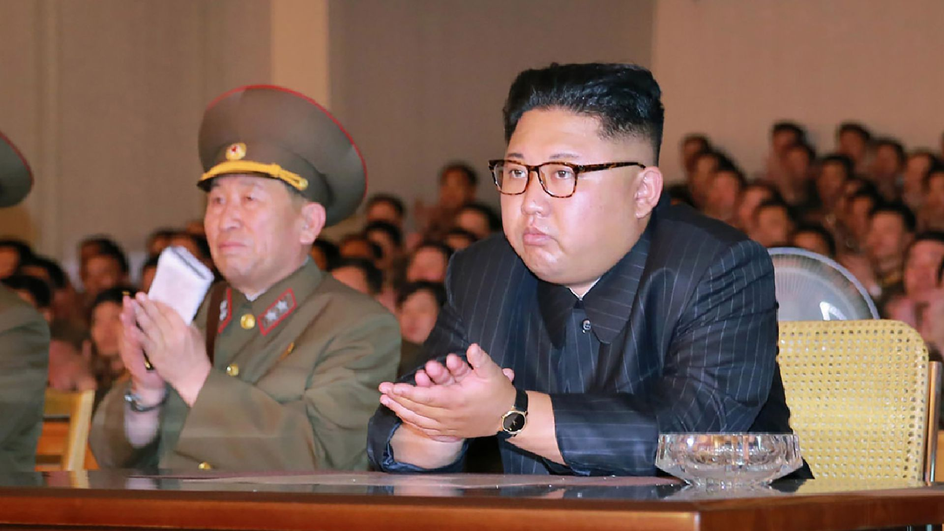 North Korean leader Kim Jong-Un (C) clapping hands while viewing a stage during his inspecting the Command of the Strategic Force of the Korean People's Army