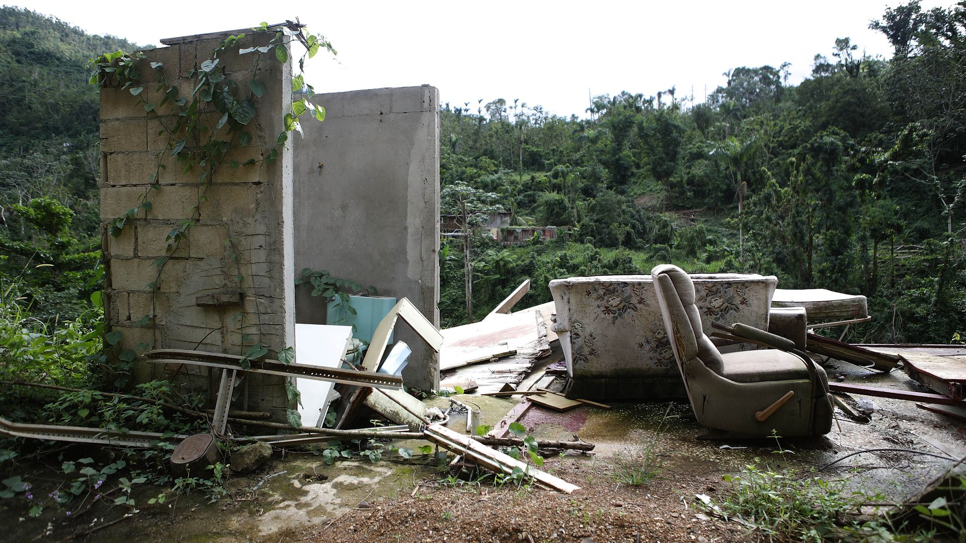 Forlorn couch sits amongst a ruined house