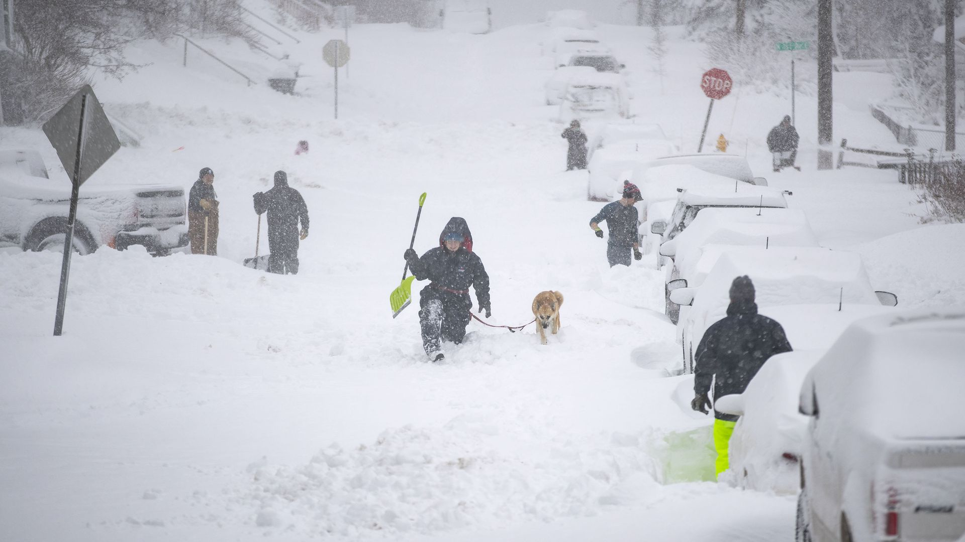 Neighbors worked together Sunday morning in an effort to clear out as much snow as possible from E. 8th St. in Duluth, Minnesota.