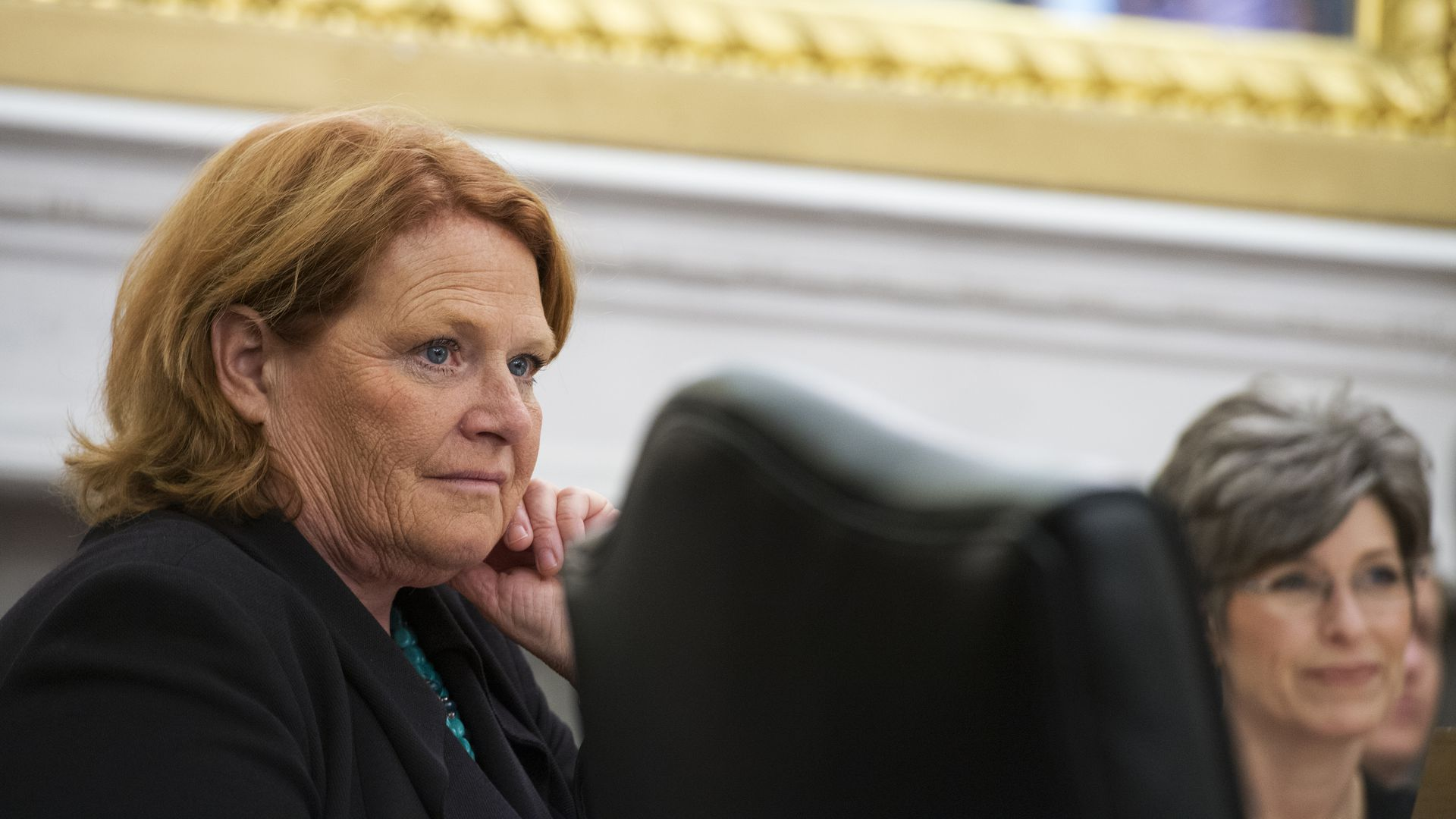 Heidi Heitkamp looking at someone with her hand on her cheek