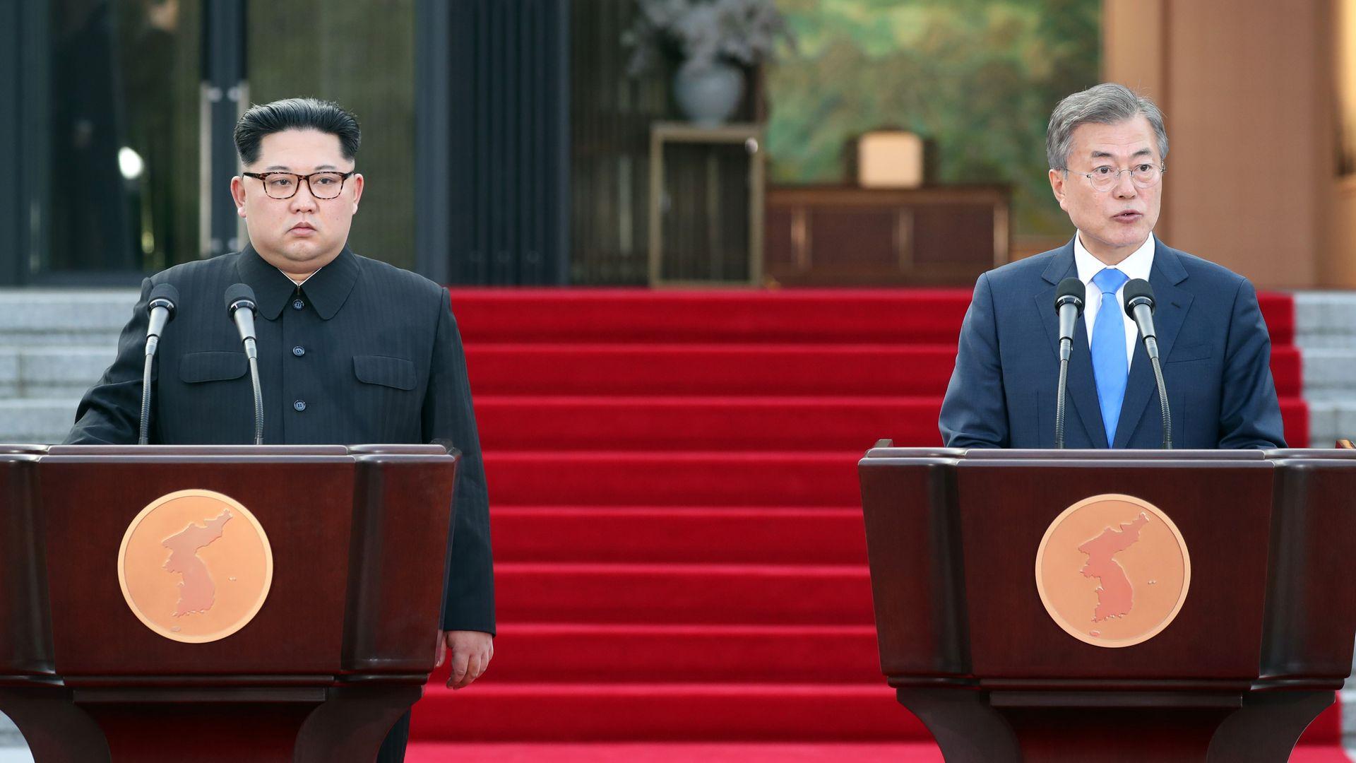 Kim Jong-un and Moon Jae-in look bored.