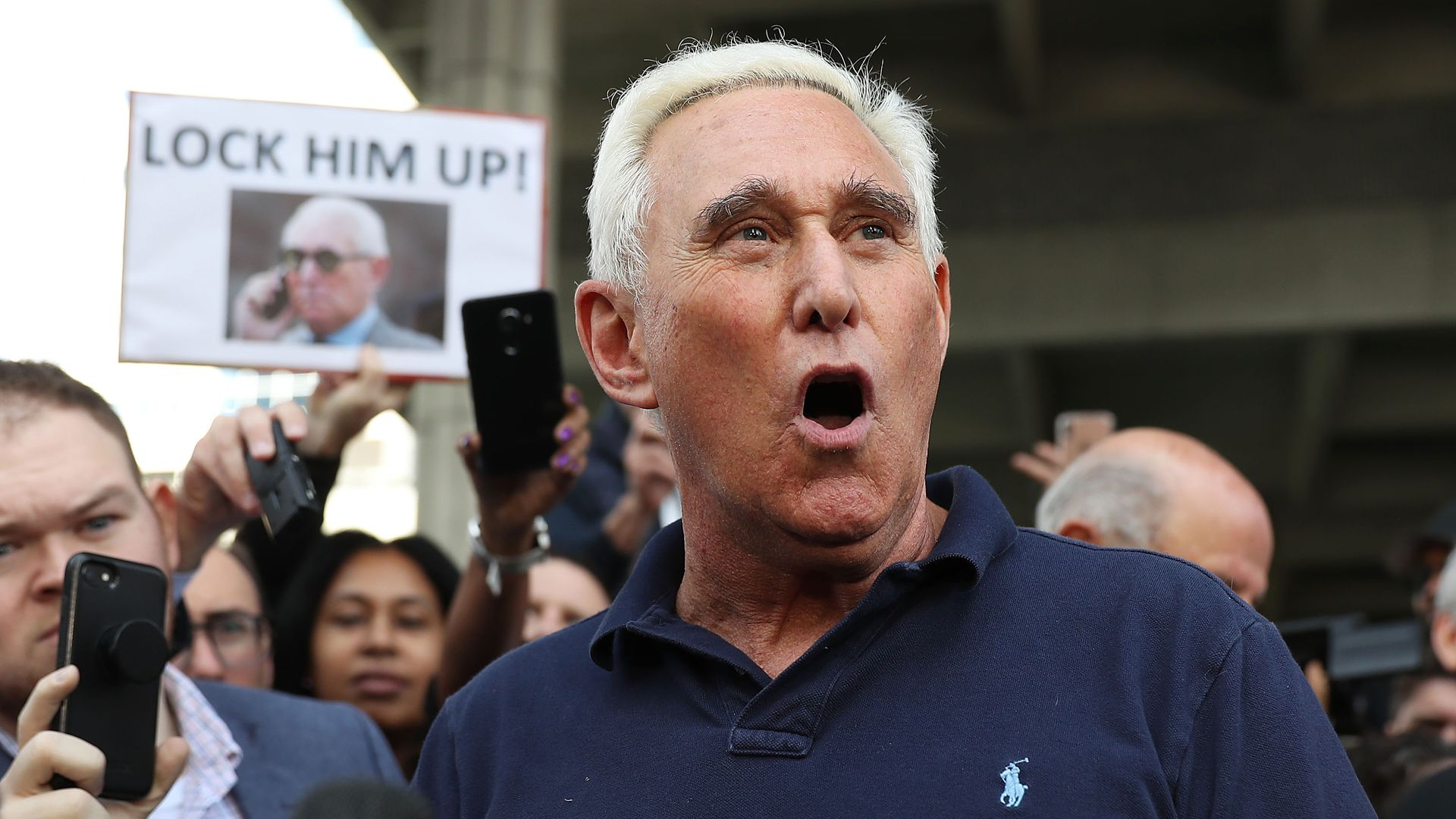 Roger Stone speaks to a crowd after his arrest