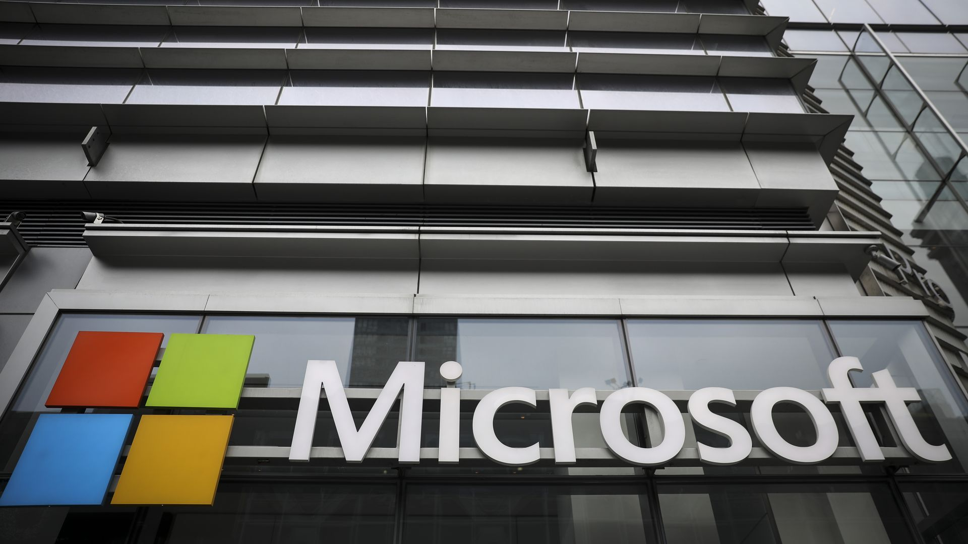 Microsoft name and Windows logo on side of a modern office building