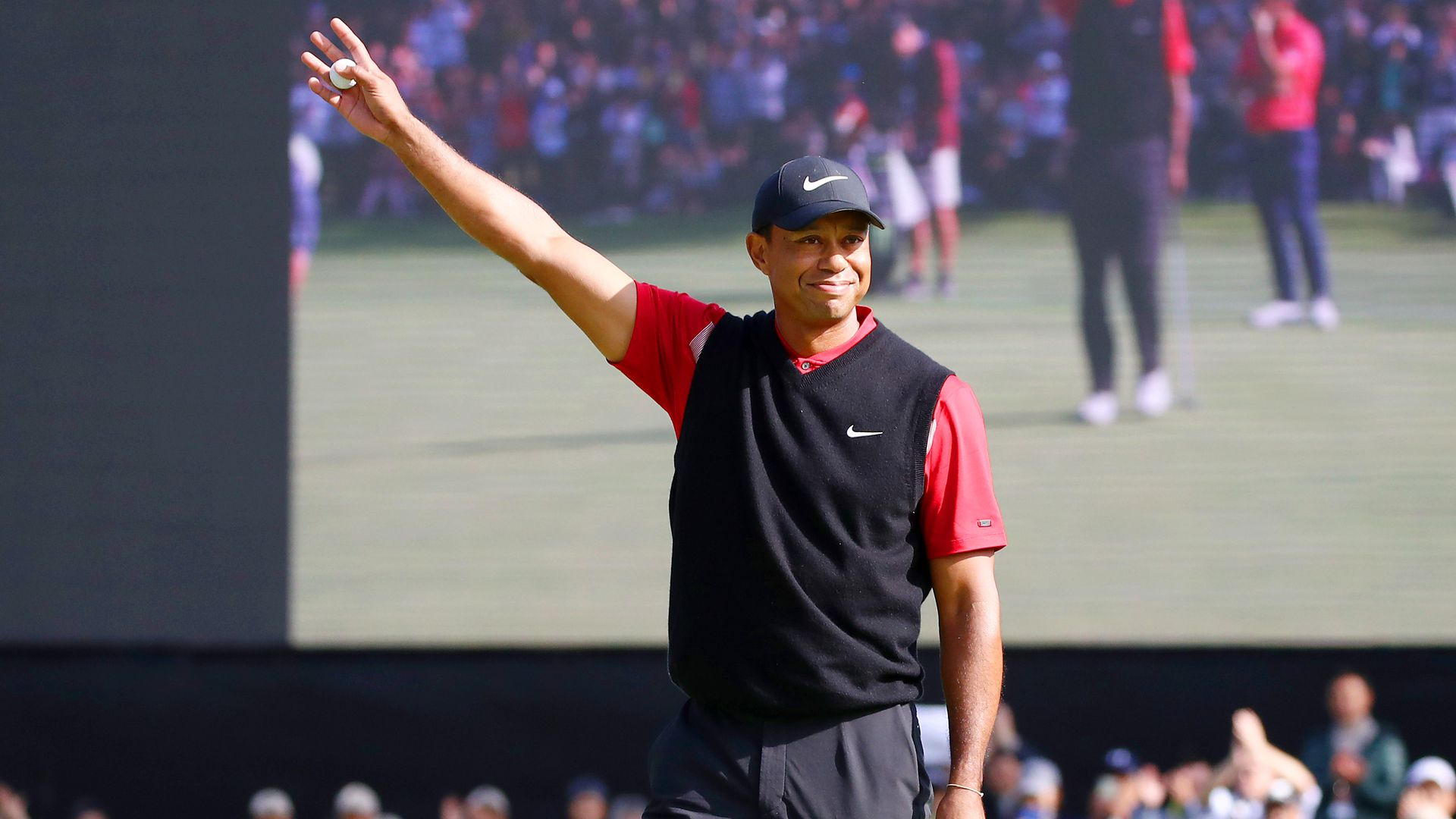 Tiger Woods of the United States celebrates winning the tournament on the 18th green during the final round of the Zozo Championship at Accordia Golf Narashino Country Club on October 28
