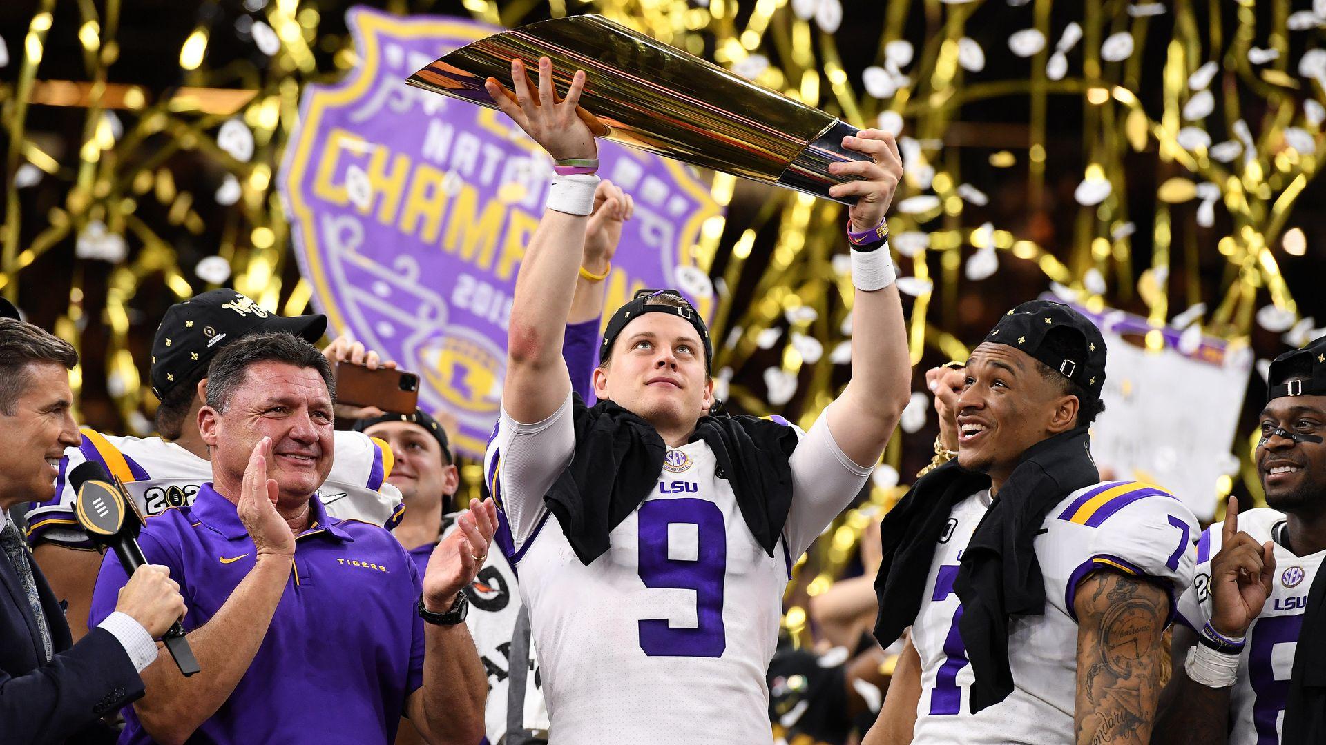 Joe Burrow holding up the trophy