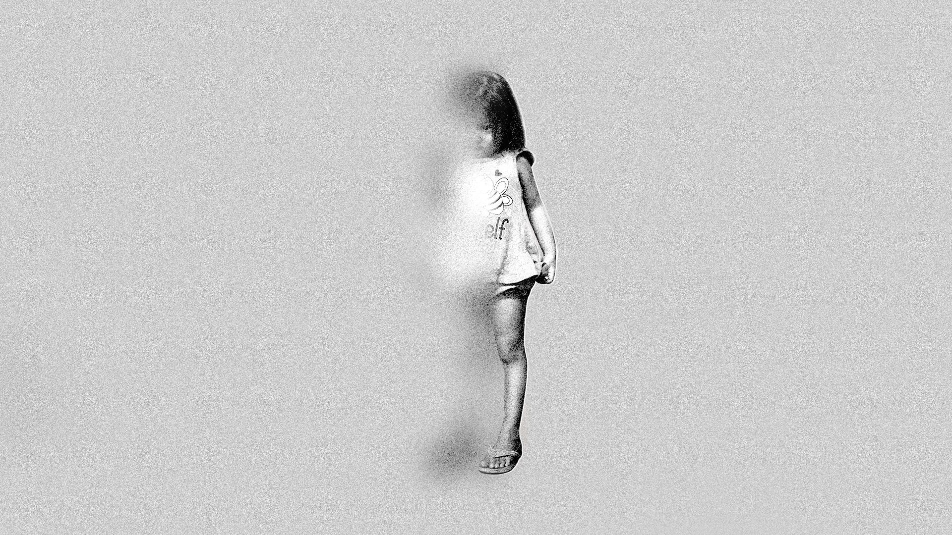 Image of young girl fading into a gray background