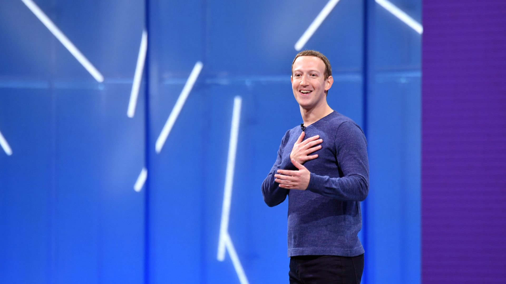 Mark Zuckerberg on stage with hand on heart