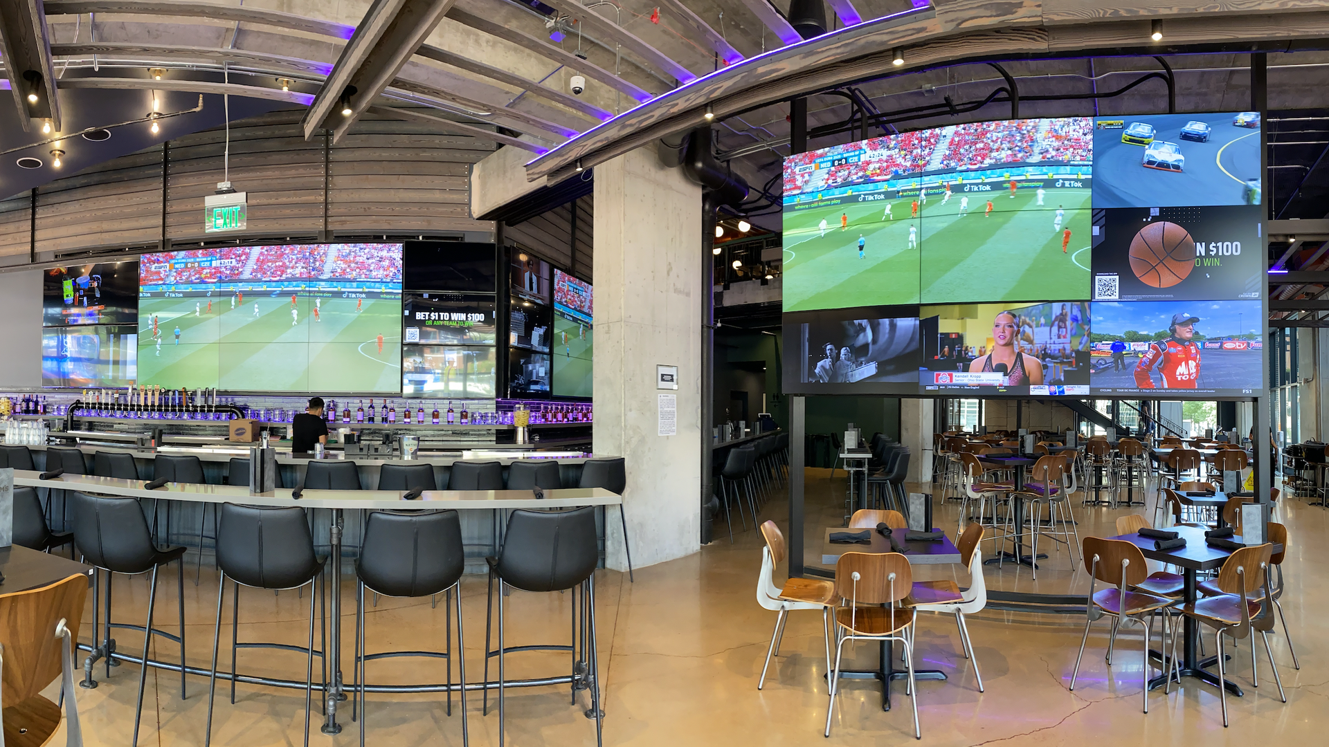 Inside a bar with big-screen TVs