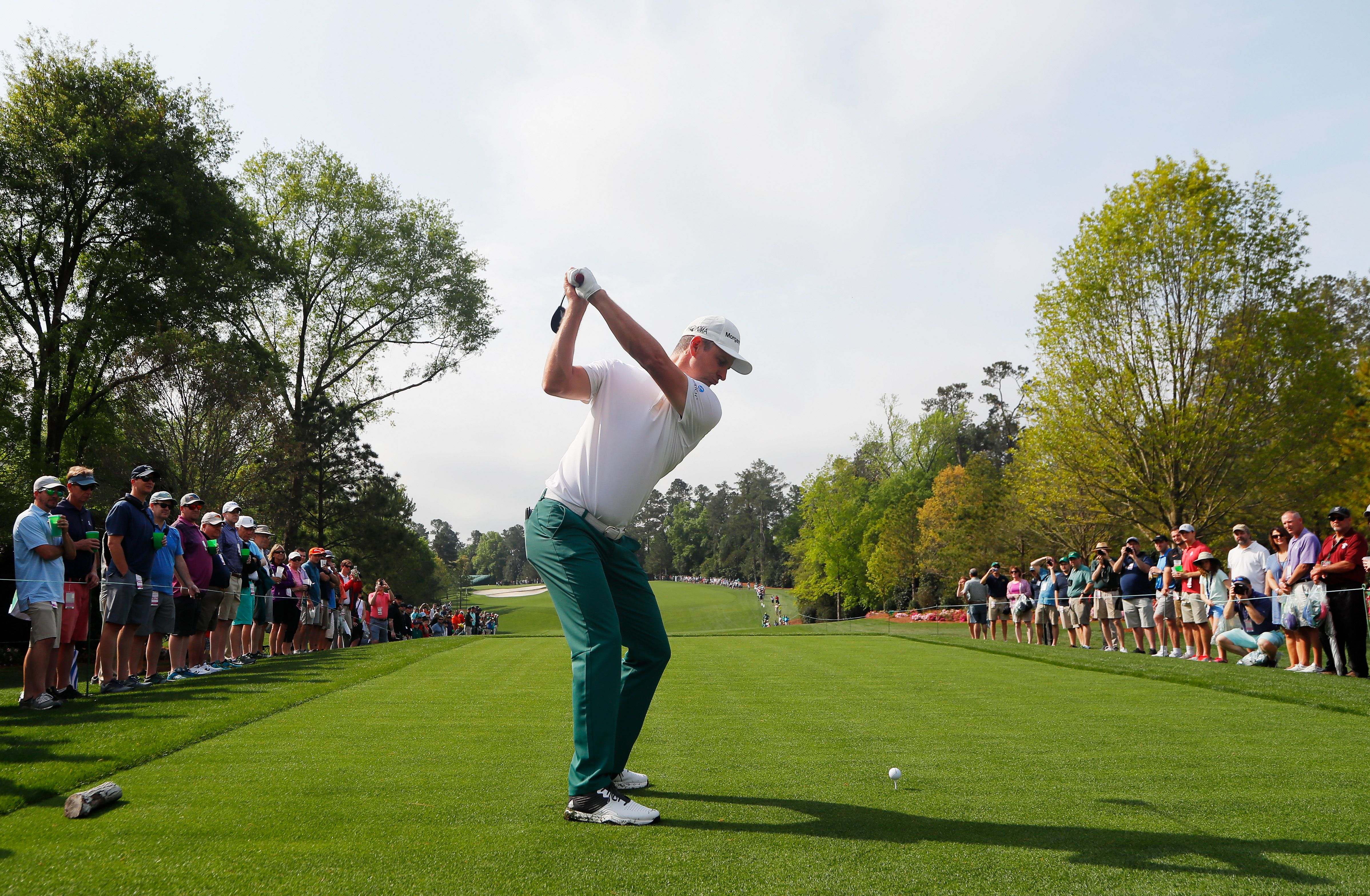 Justin Rose of England plays his shot from the fifth tee
