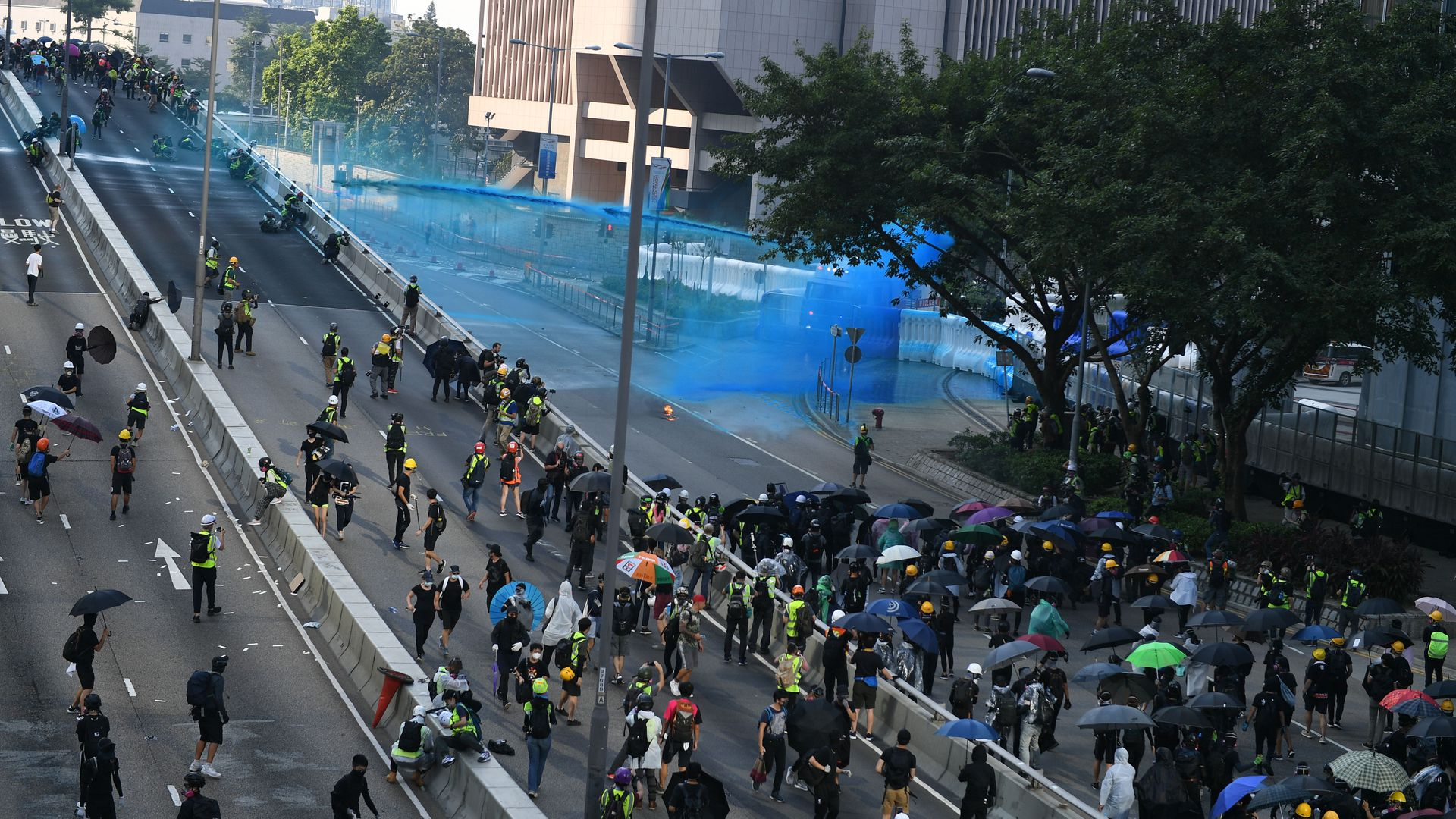 Hong Kong police fire water cannon from the central government complex