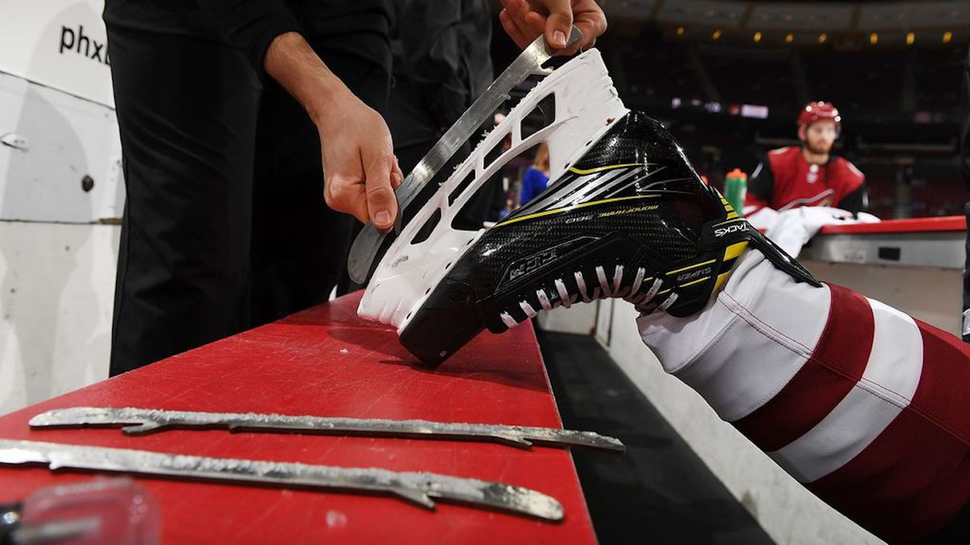 Someone sharpening a hockey blade