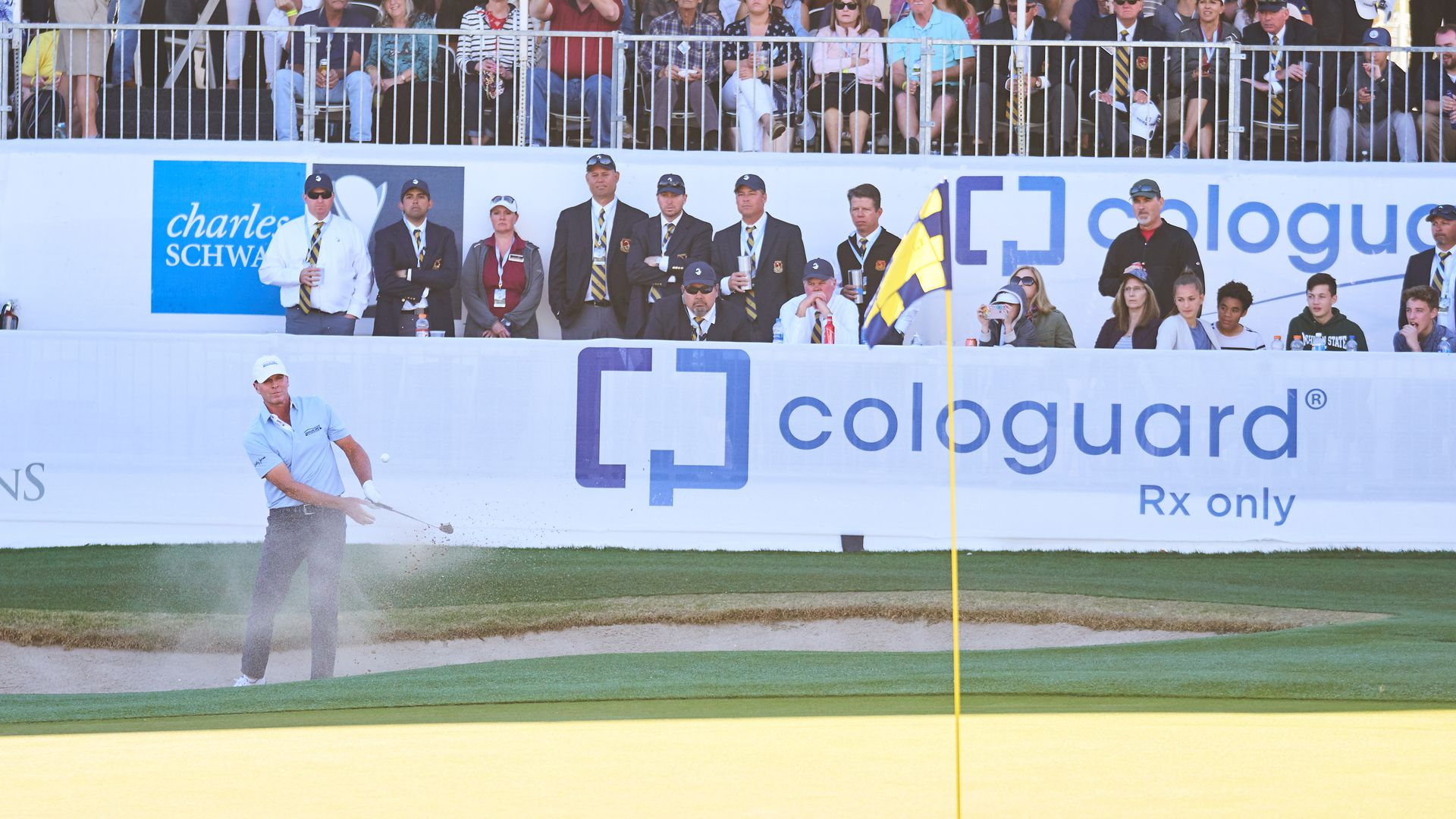 A golfer hits a shot at a 2018 tournament sponsored by Cologuard.