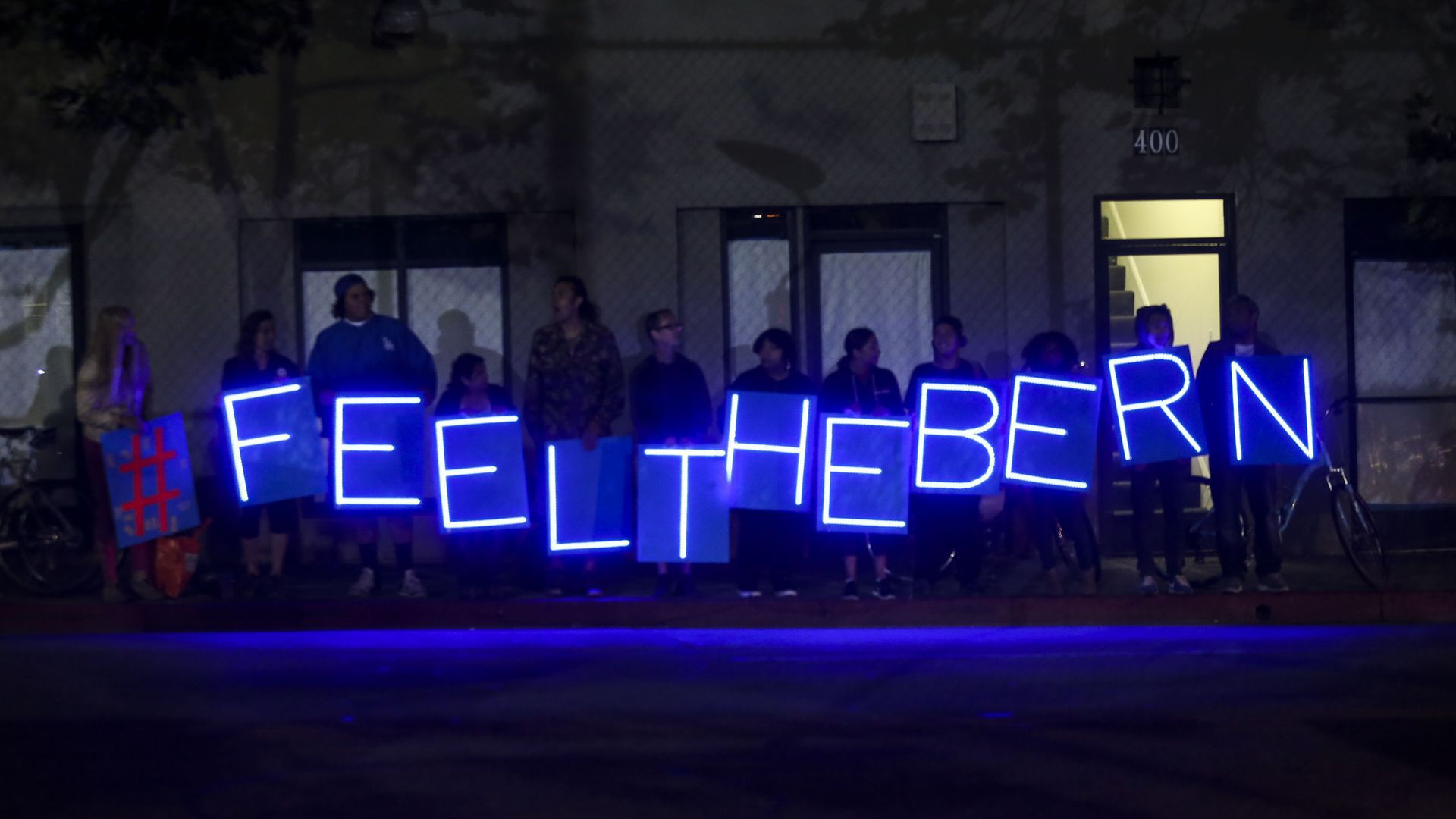 Light up sign people are holding that says #feelthebern