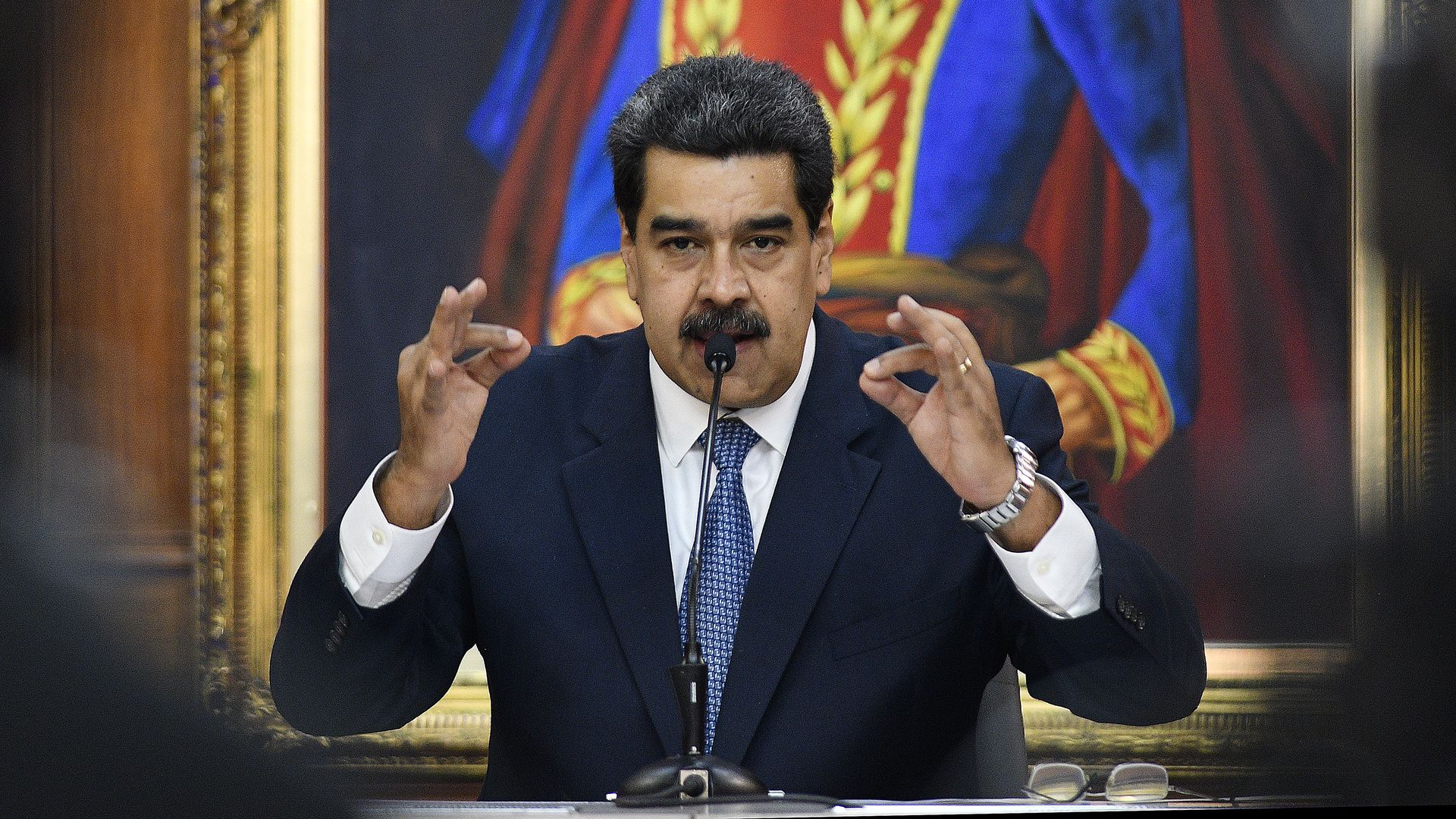 Nicolas Maduro speaking at a lectern