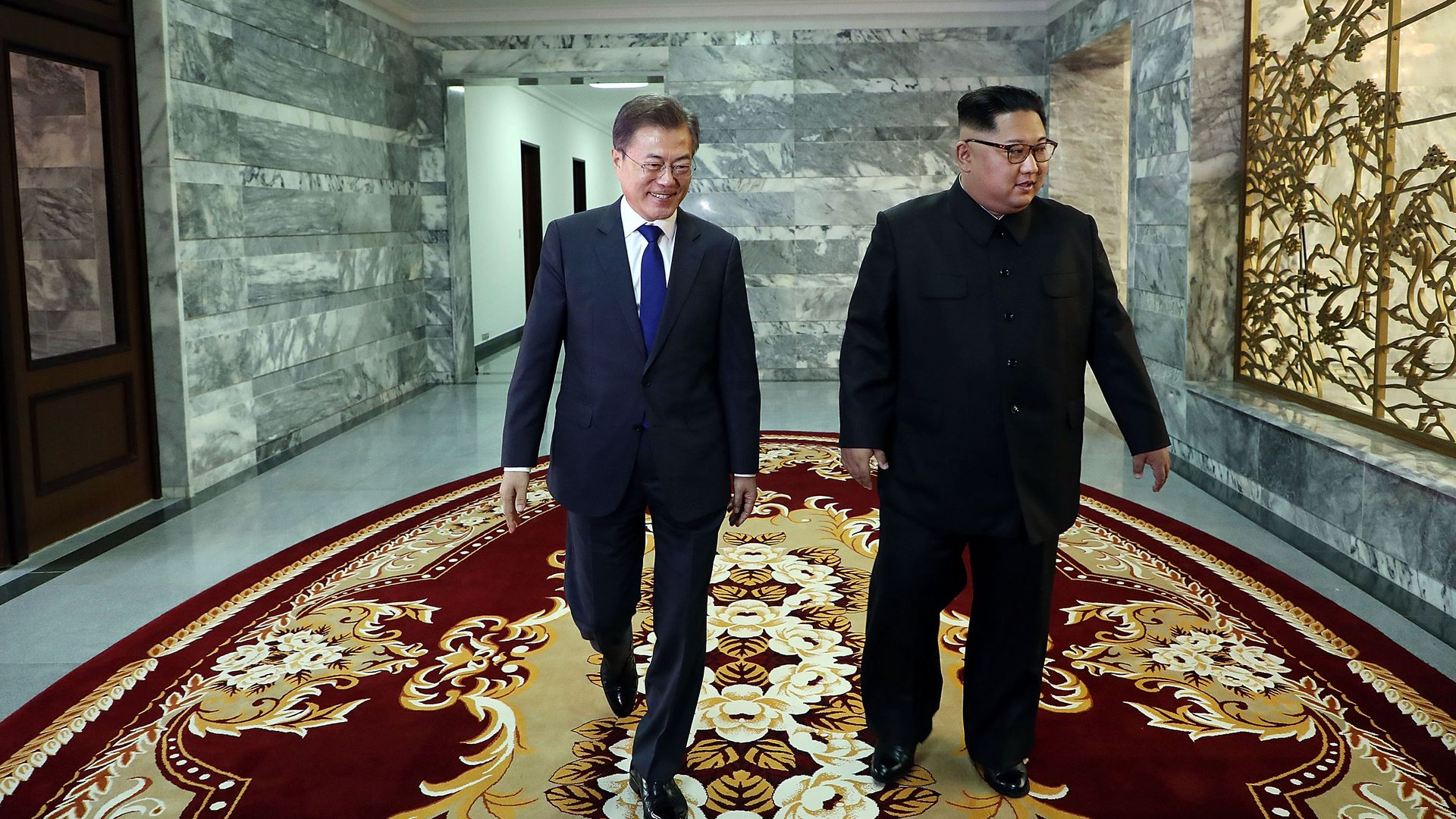 South Korean President Moon Jae-in walks with North Korean leader Kim Jong-un during their meeting on Saturday.